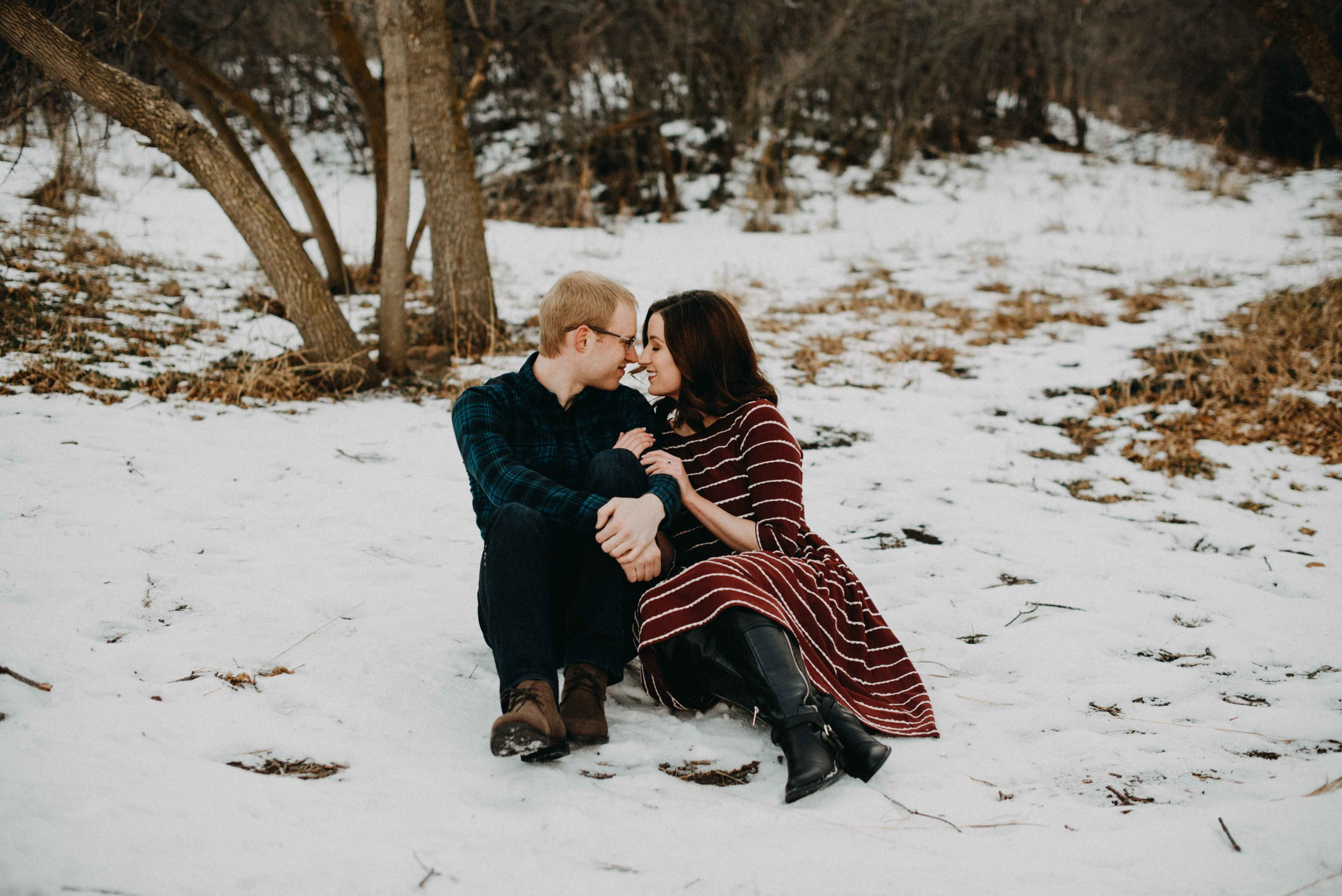 Trinity and Peter hugging in the snow during their snowy engagement session. We went to Chautauqua and spent the afternoon hiking around for their couples portraits!