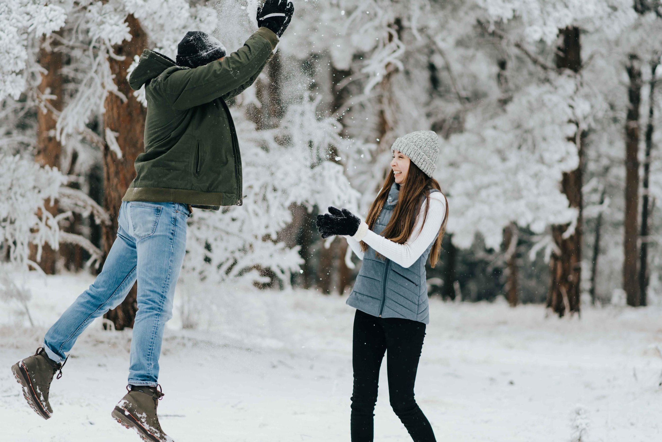 Nik and Tani during their snowy engagement session. Nik got a snowball to the face, so Tani was not going to be shown any mercy!