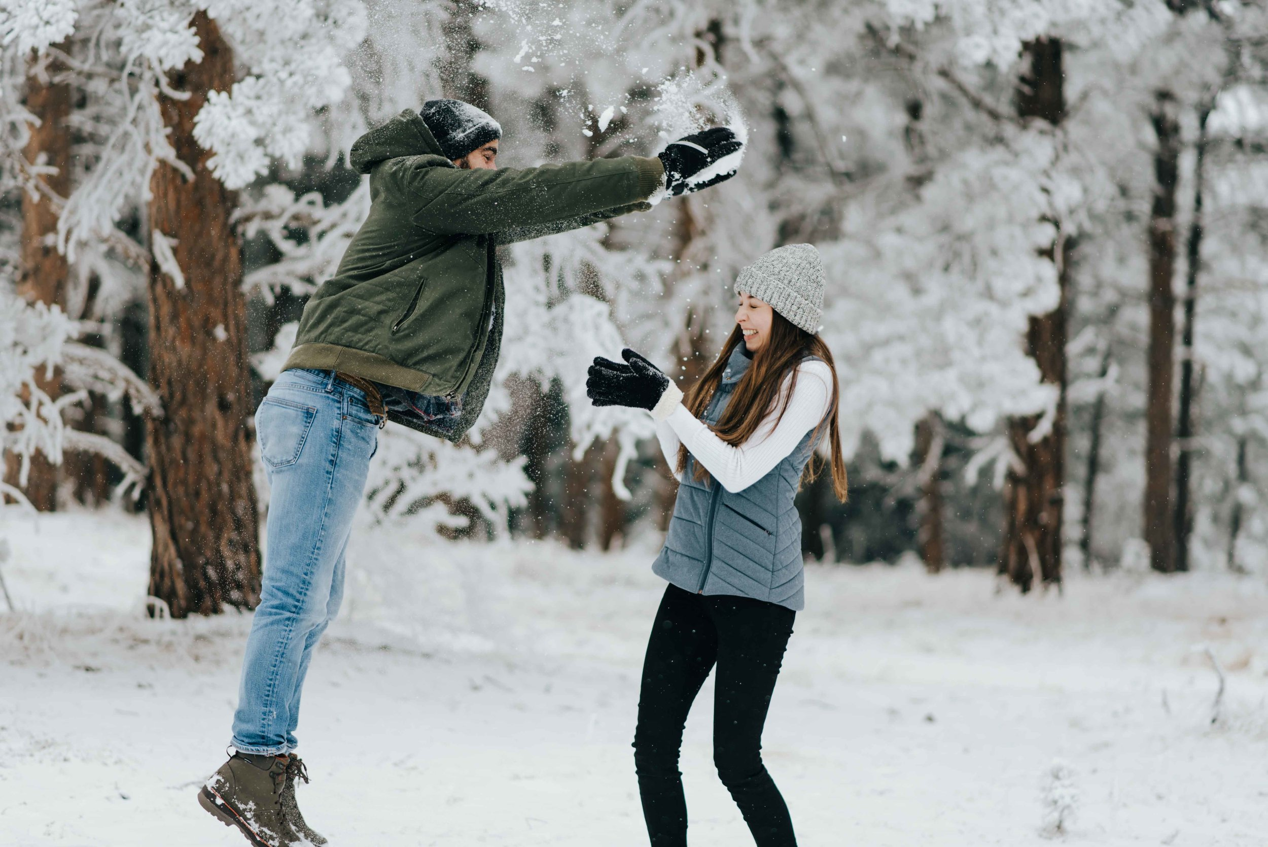 Nik and Tani during their mountain engagement session in Golden, Colorado. Here they are in the midst of an epic snowball fight!