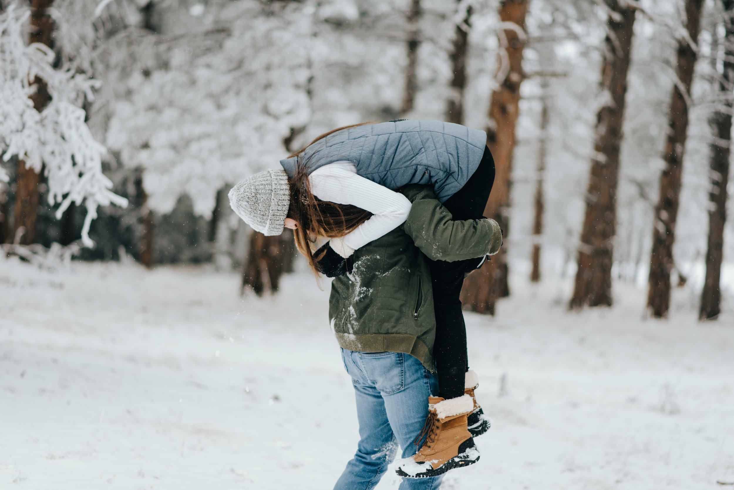 Nik picking Tani up during their epic snowball fight.