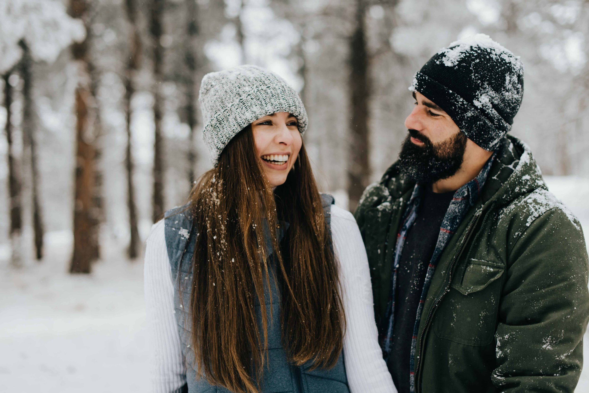 Nik admiring Tani as she laughs during their Colorado engagement session.