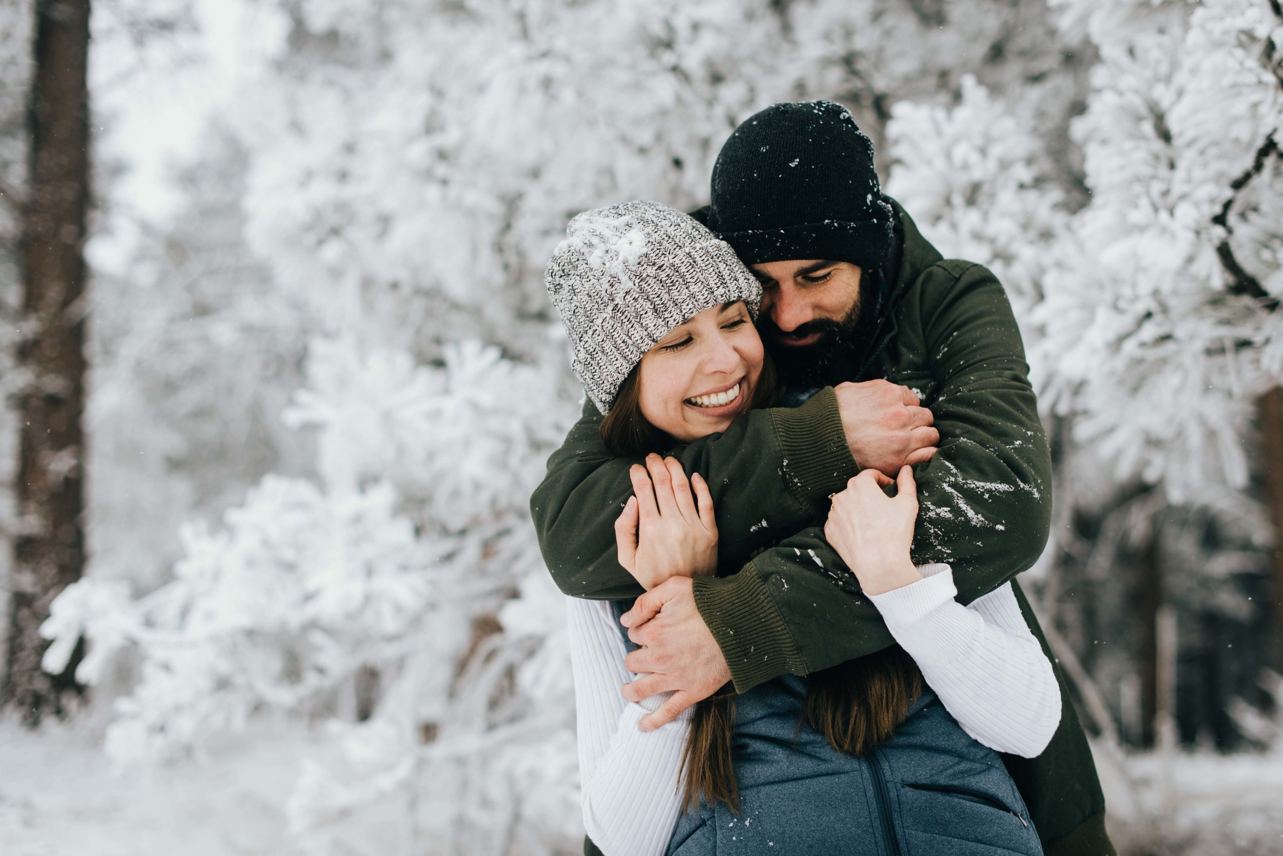 Nik and Tani hugging during their engagement session in Colorado.