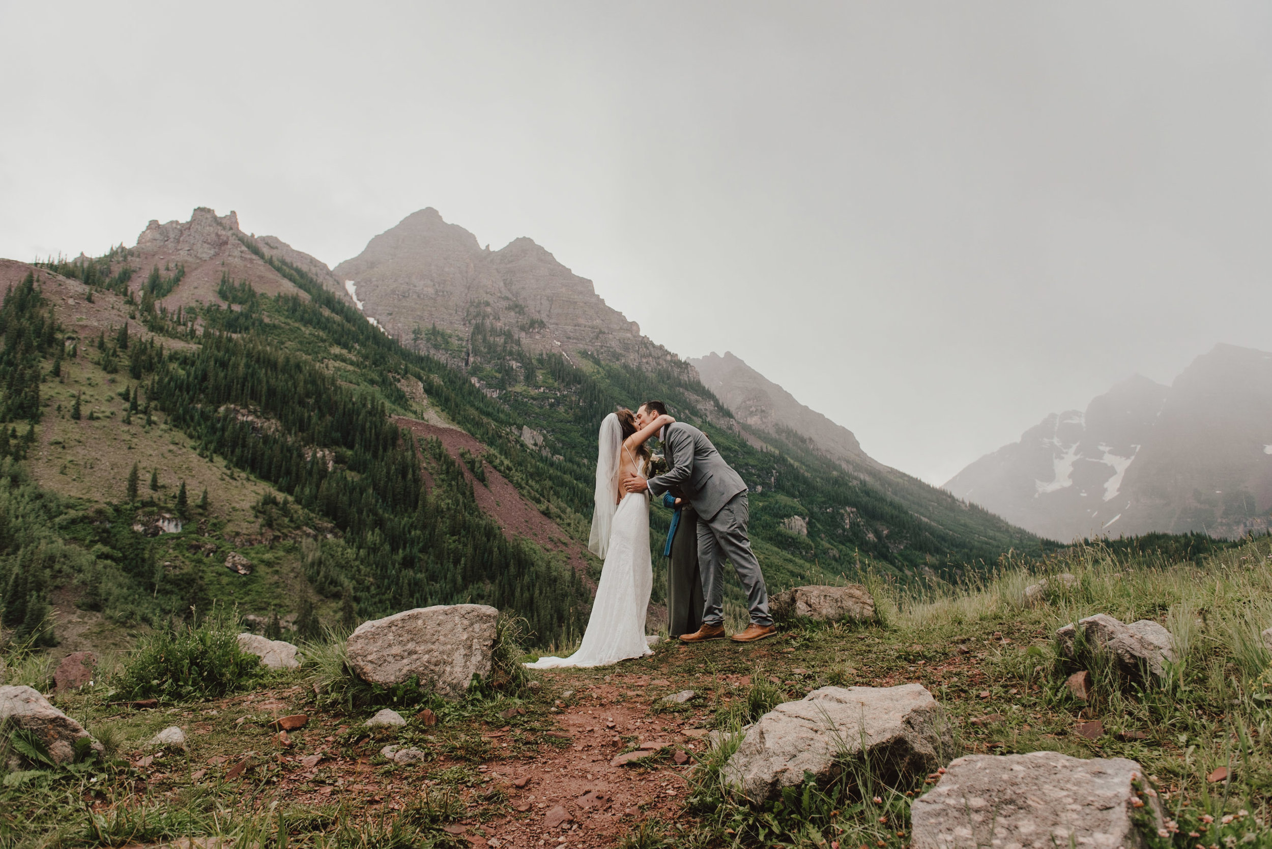 Heather and Darren sharing their first kiss as husband and wife at the Maroon Bells!