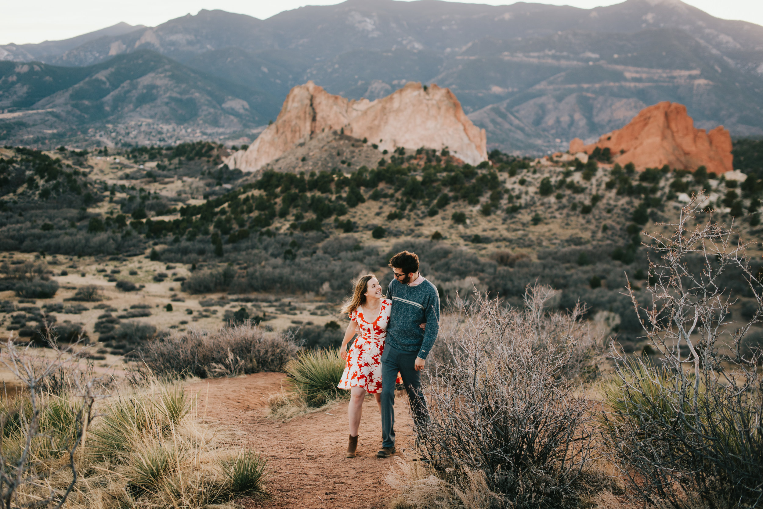 Ted and Rachel walking in Garden of the Gods during their engagement session.