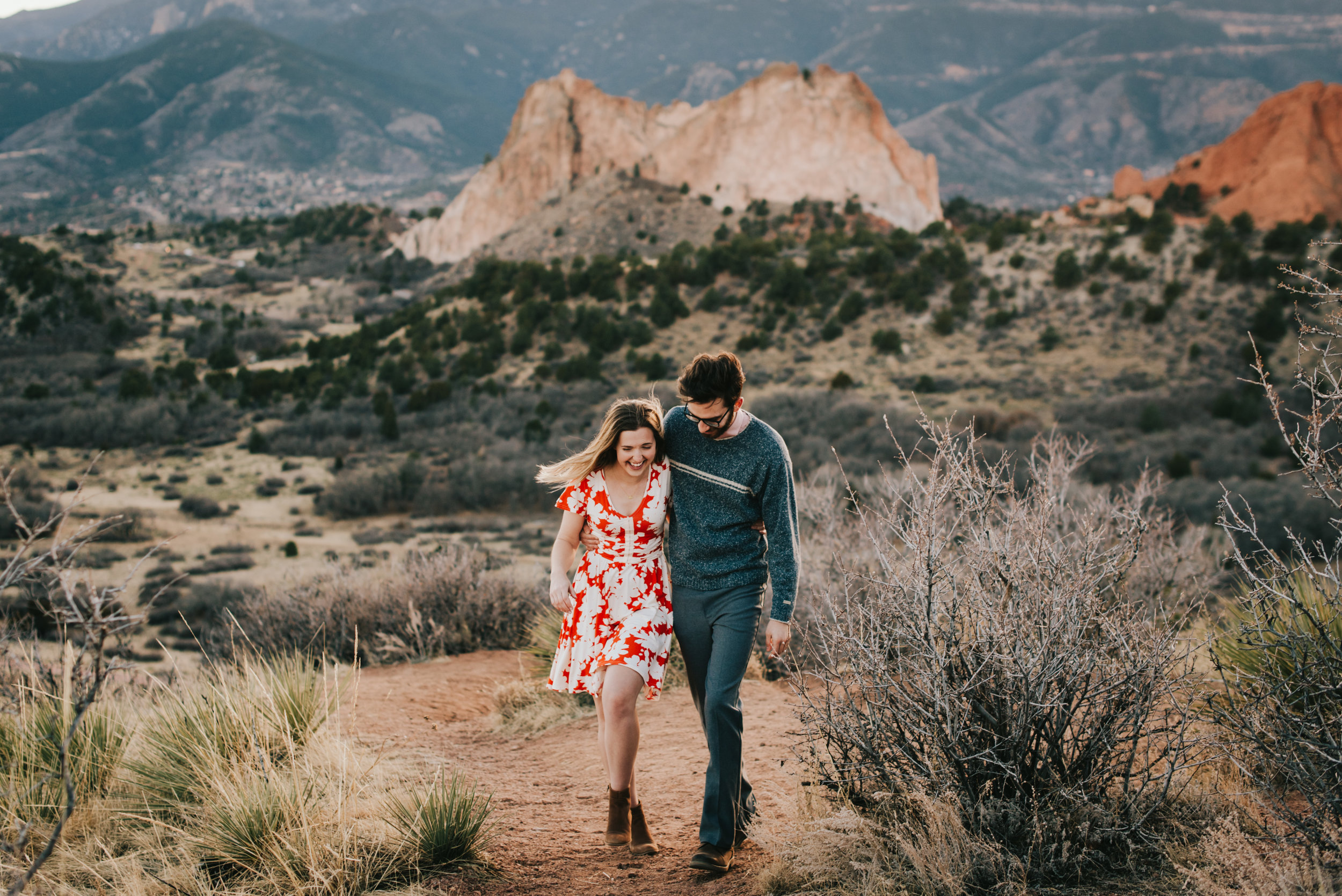 Rachel and Ted walking through Garden of the Gods in Colorado during their Colorado Springs engagement session