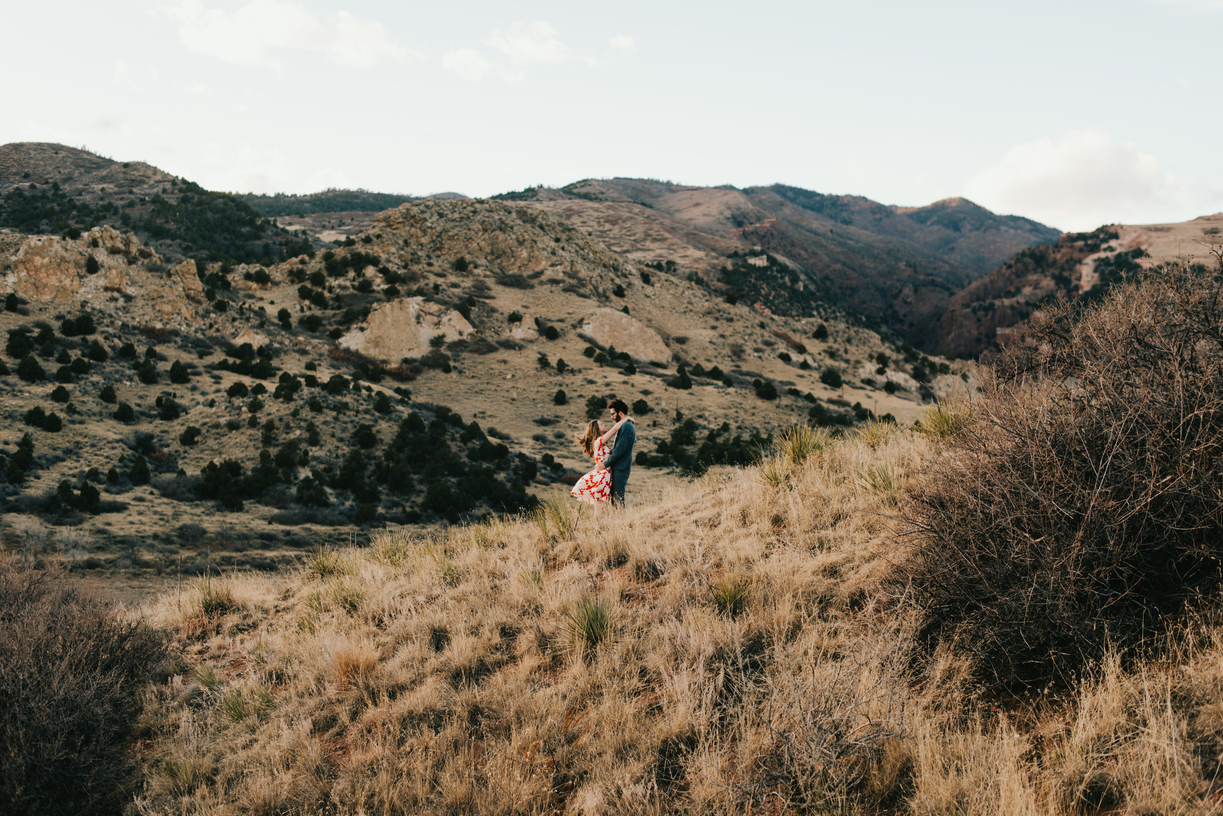 Rachel and Ted embracing in the hills of Colorado Springs.