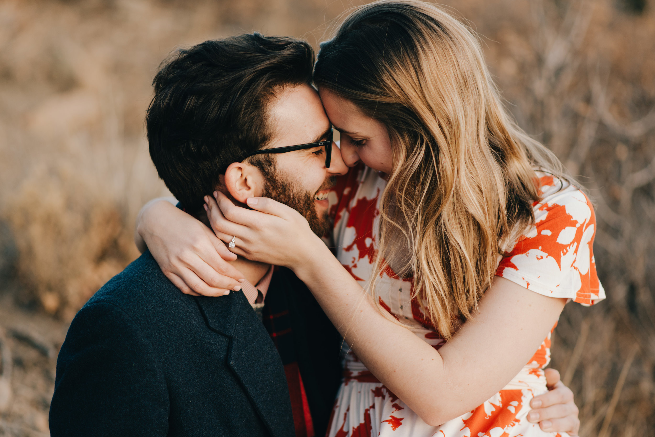 Rachel and Ted snuggling during their engagement session at Garden of the Gods in Colorado Springs.