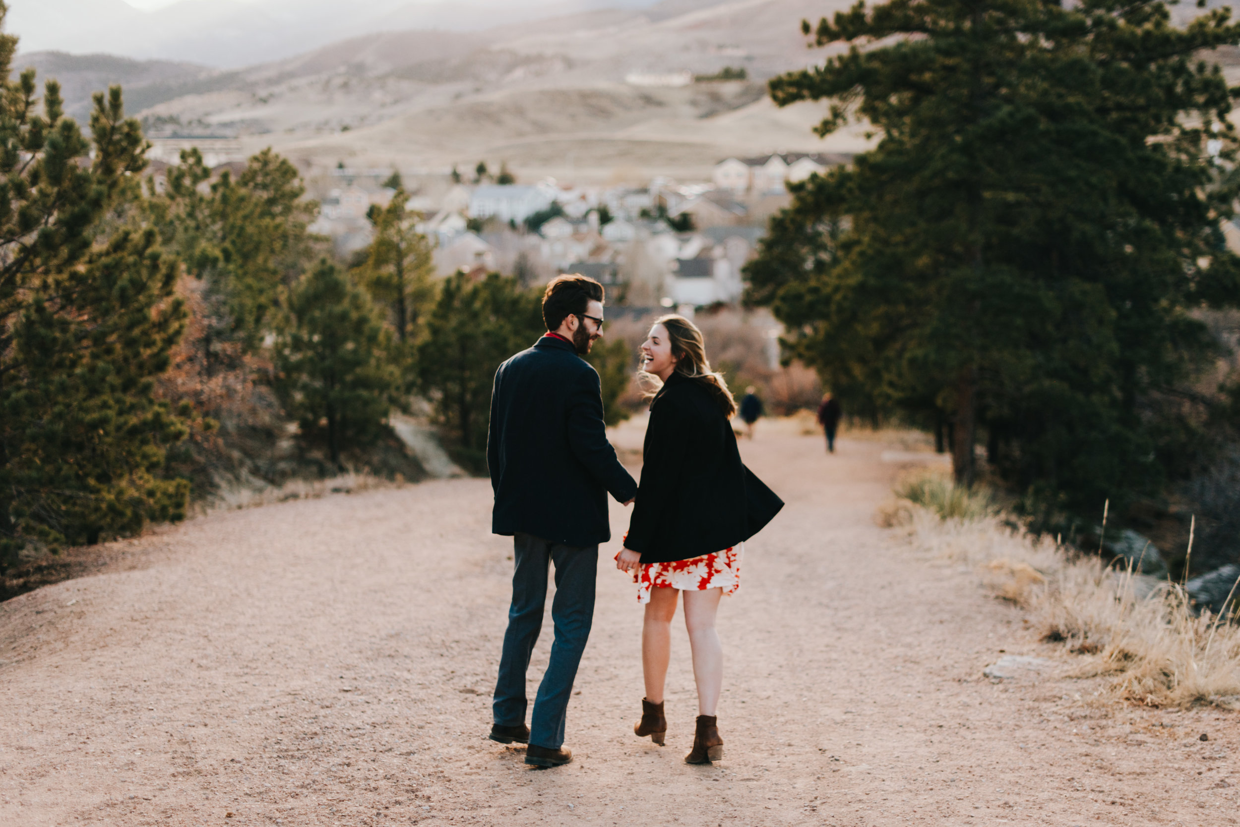Ted and Rachel, laughing as they walk.