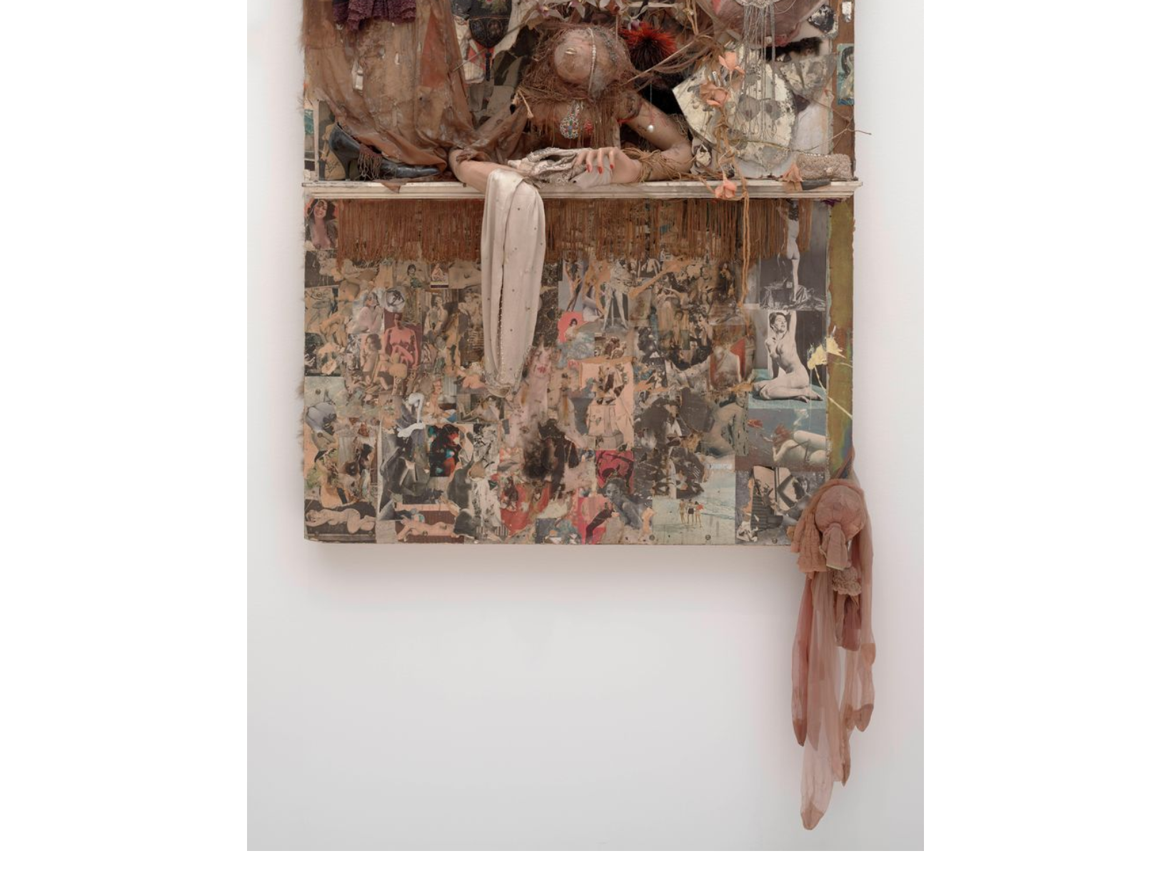 Bruce Conner,LOOKING GLASS, 1964; Mannequin arms, dried blowfish, painted wood, mirror, fringe, shoe, heart-shaped, cut and pasted printed papers, paint, nylon, fabric, jewelry, beads, string, doll voice box, fur, artificial flowers, feathers, garter clip, tinsel, and metal on Masonite, 60 1/2 x 48 x 14 1/2 in. (153.67 x 121.92 x 36.83 cm); Collection SFMOMA, San Francisco Museum of Modern Art. Gift of the Modern Art Council; © Conner Family Trust, San Francisco / Artists Rights Society (ARS), New York  sfmoma.org