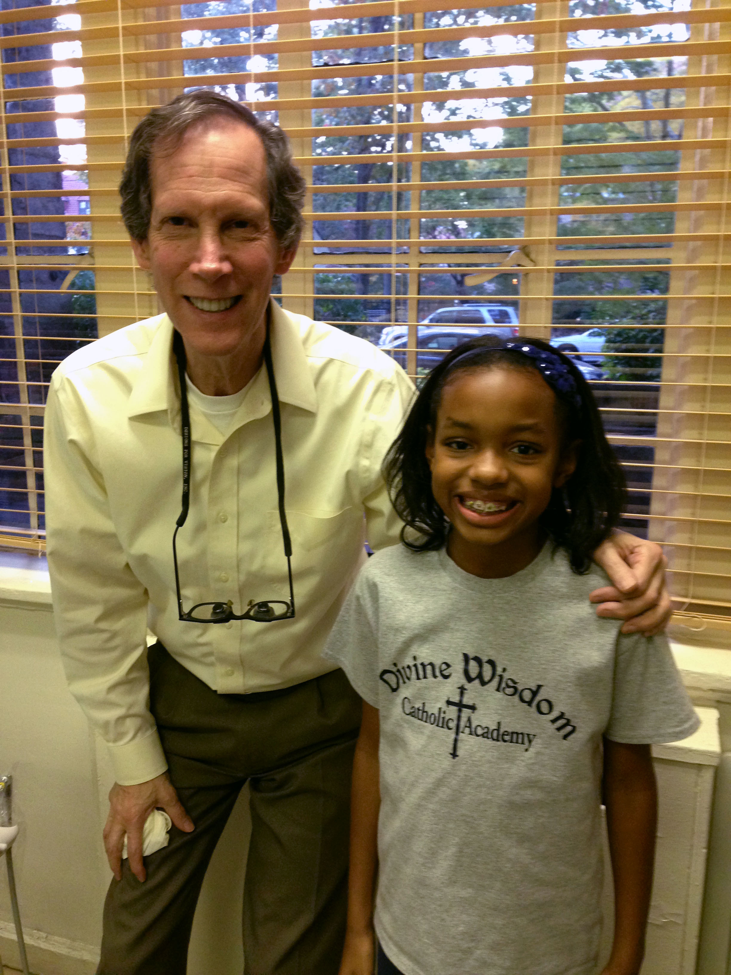 dr. halberstadt and a young patient with her new braces bronx ny