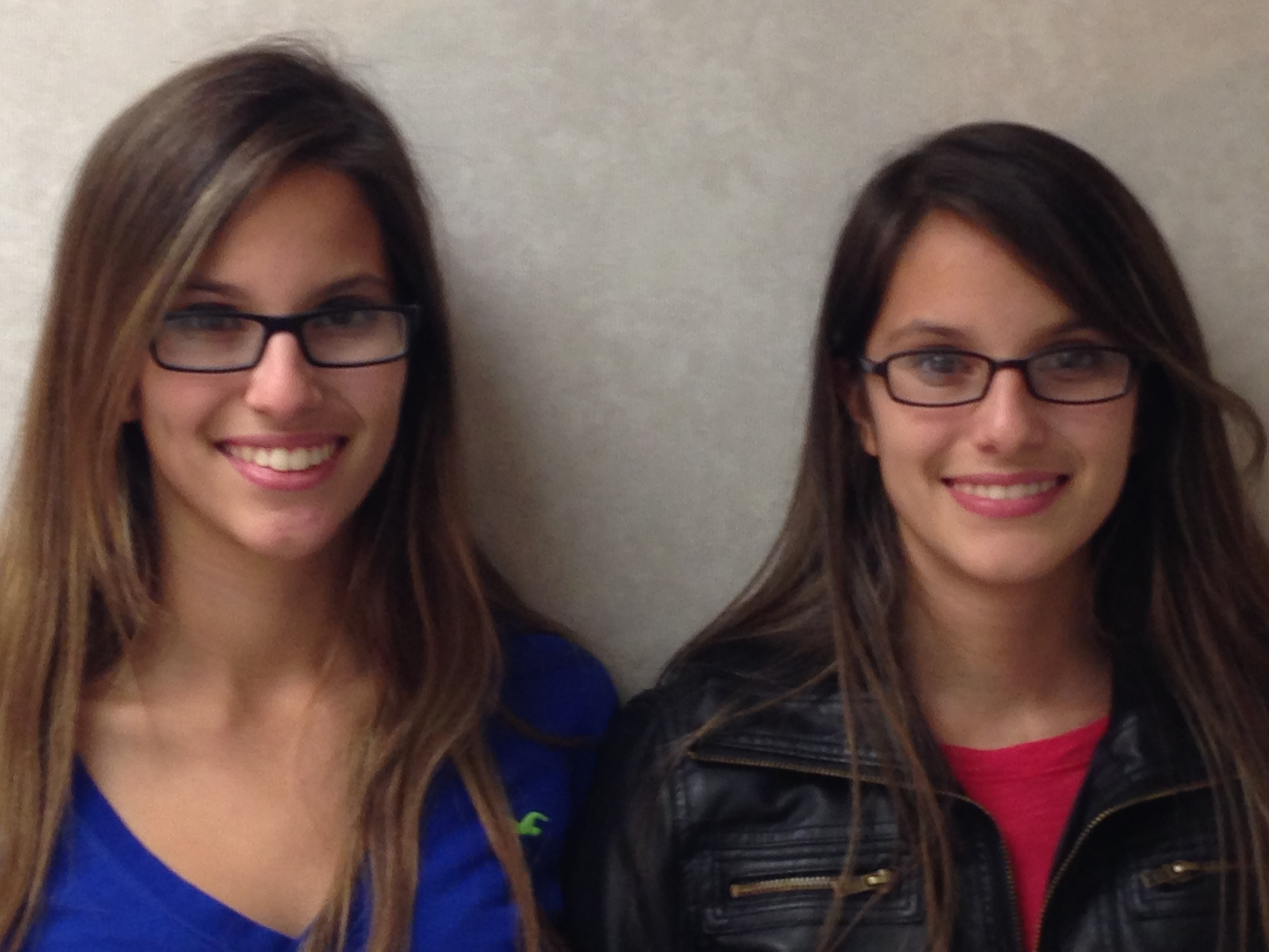 These sisters are smiling after having their braces removed at our Rockville Centre office. They are now in their retention phase of treatment.