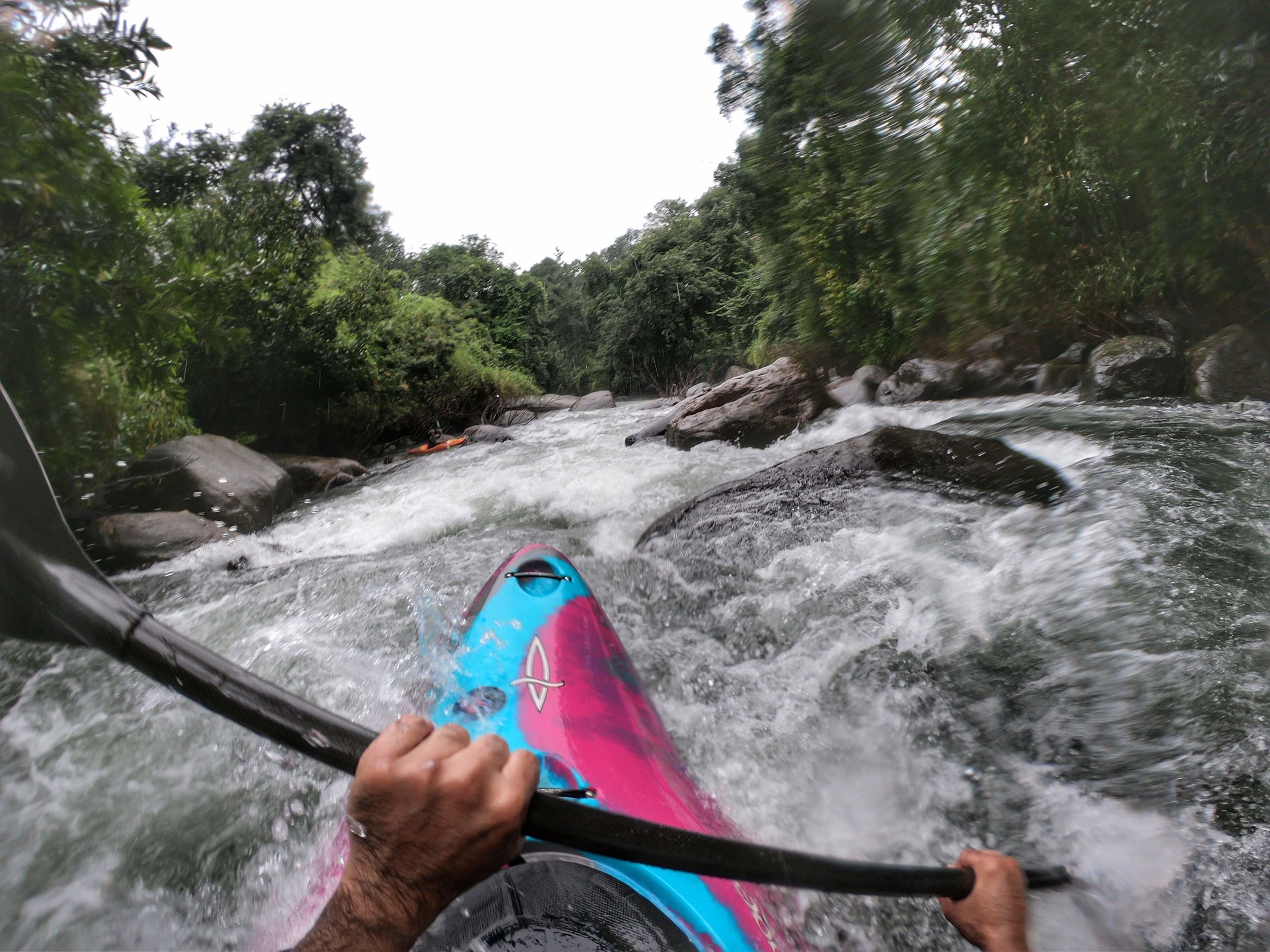 Kayaker running Jungle pinball on the Chalipuzha