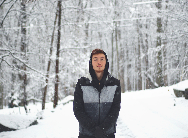 I took this photo while I was in the Poconos with my family on Thanksgiving. They got 7 inches of snow over night so I snapped some photos of my youngest brother.