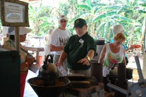 Volunteer Doug Minke teaches guests about alternative fuels and improved cookstoves.