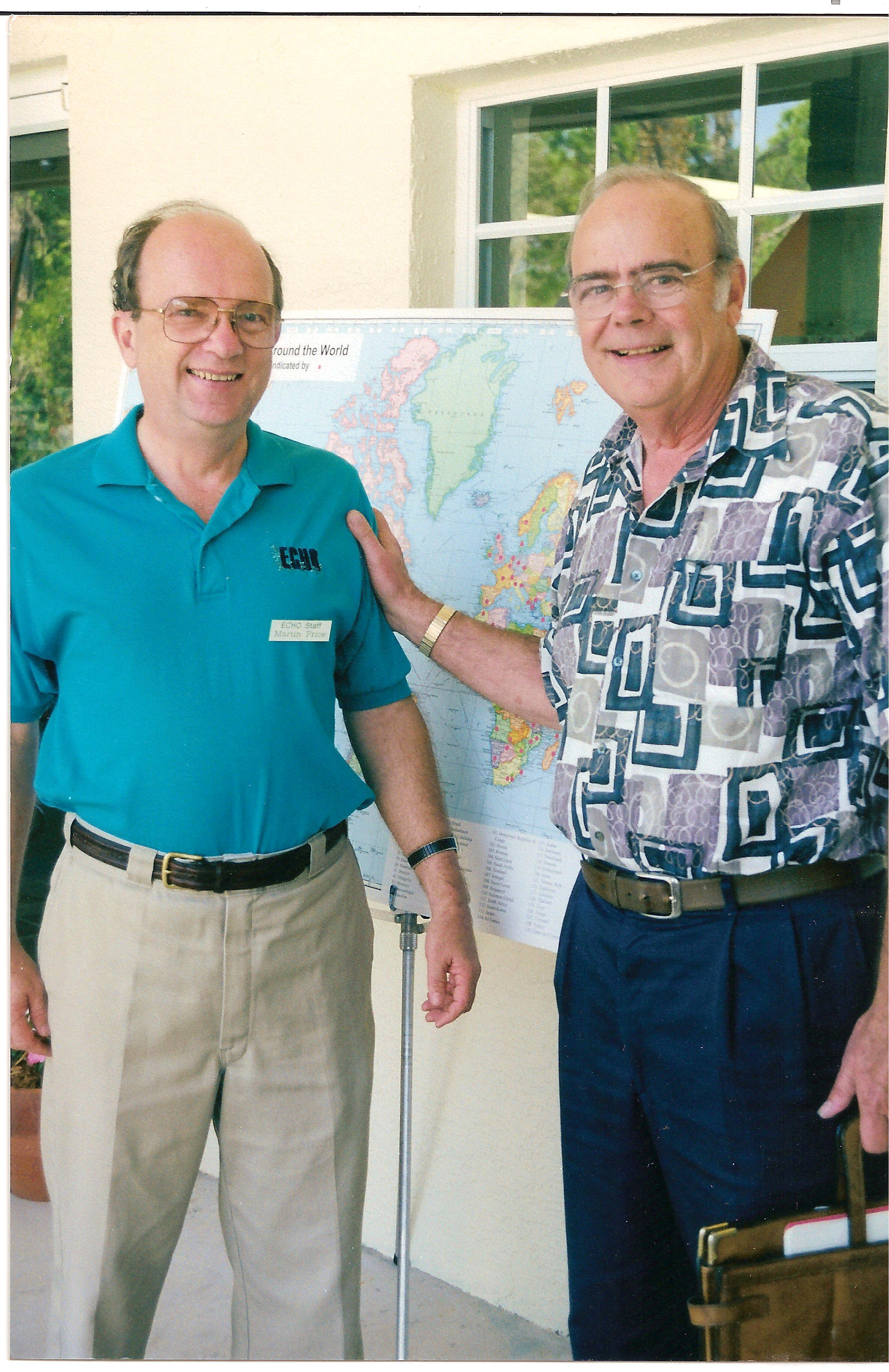 Dr. Martin Price, left, and Dick Dugger, right, at ECHO's 20th Anniversary in 2001.