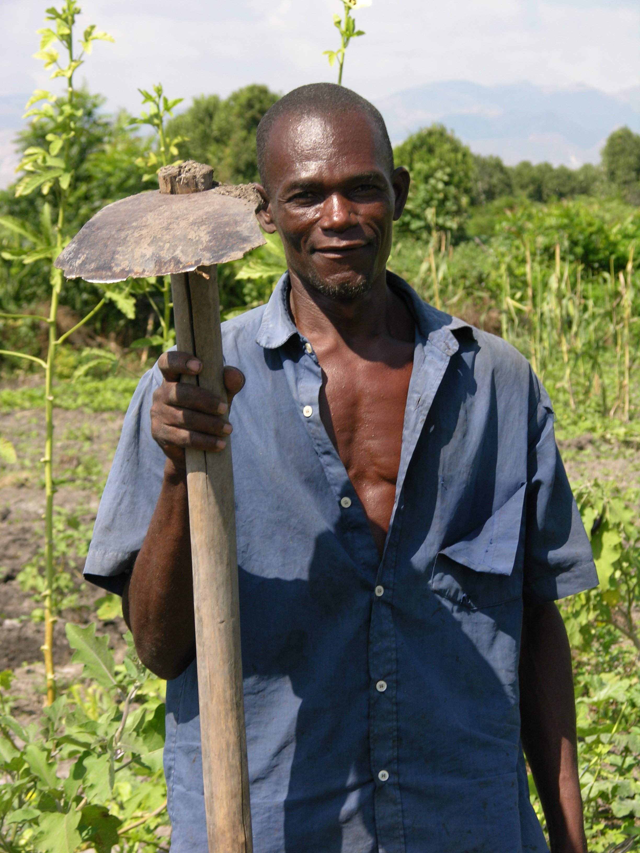 Haitian Farmer, during a visit to his fields by ECHO staff