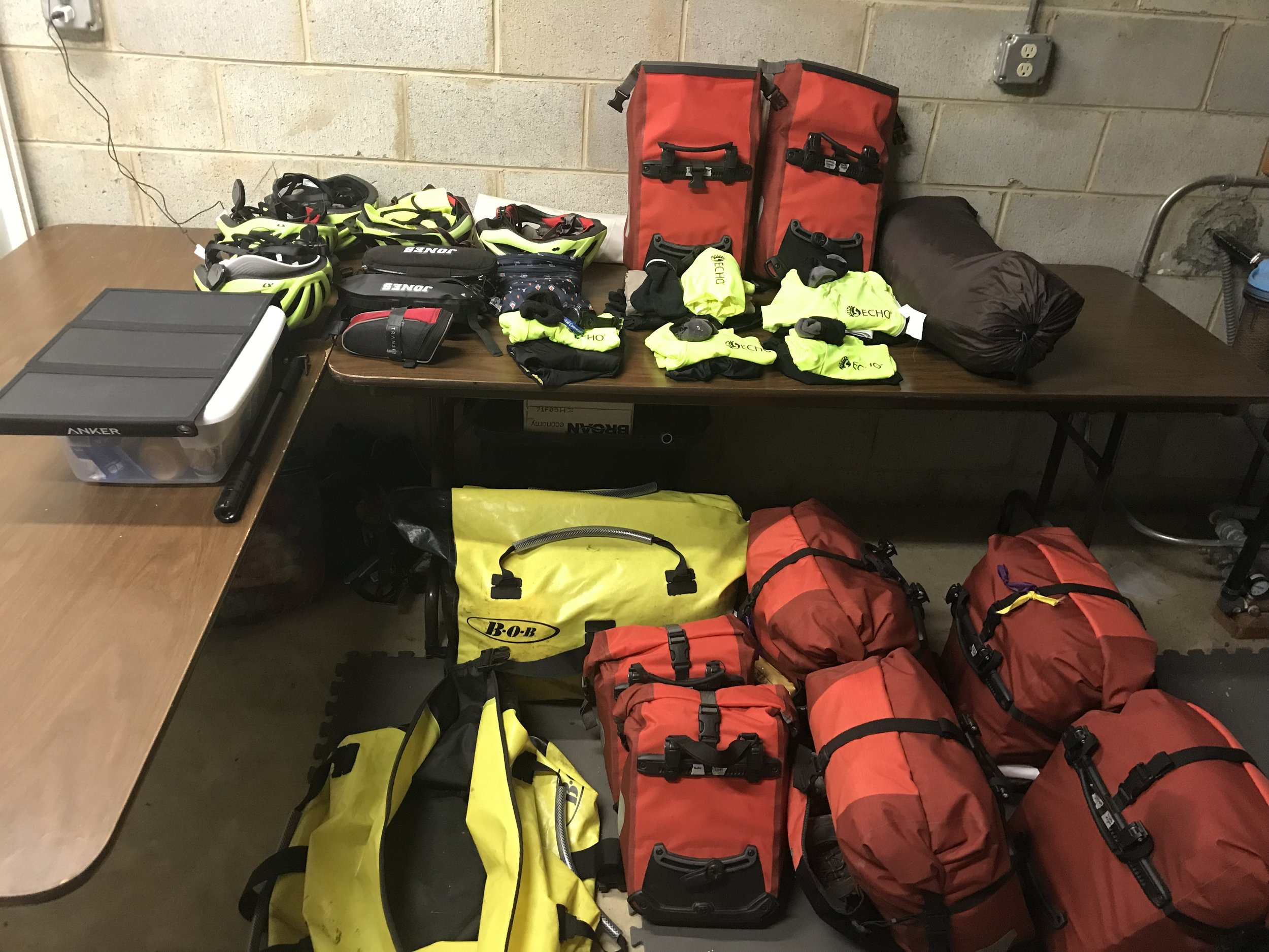 Here is our revamped gear. Look at that EMPTY (yellow/black) dry bag that WOULD go in our 2nd trailer!! Can anyone guess what the flat, black contraption is on the left (sitting on top of the plastic food container)? Feel free to guess and/or make comments in the comments section.