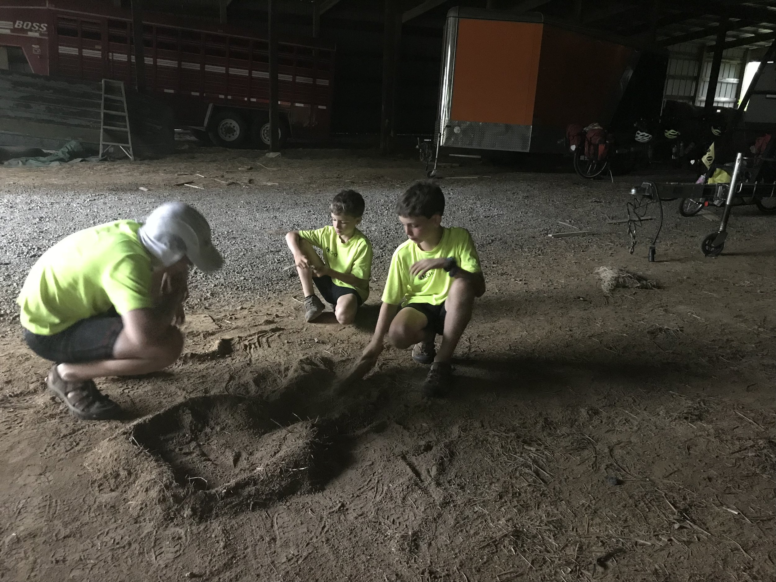 Here are the boys making forts in the dirt. They came up with their own game, which involved destroying each other's forts in a systematic way, and then we had to vote on whose fort was most destroyed based on its original condition. The things that amuse boys!!