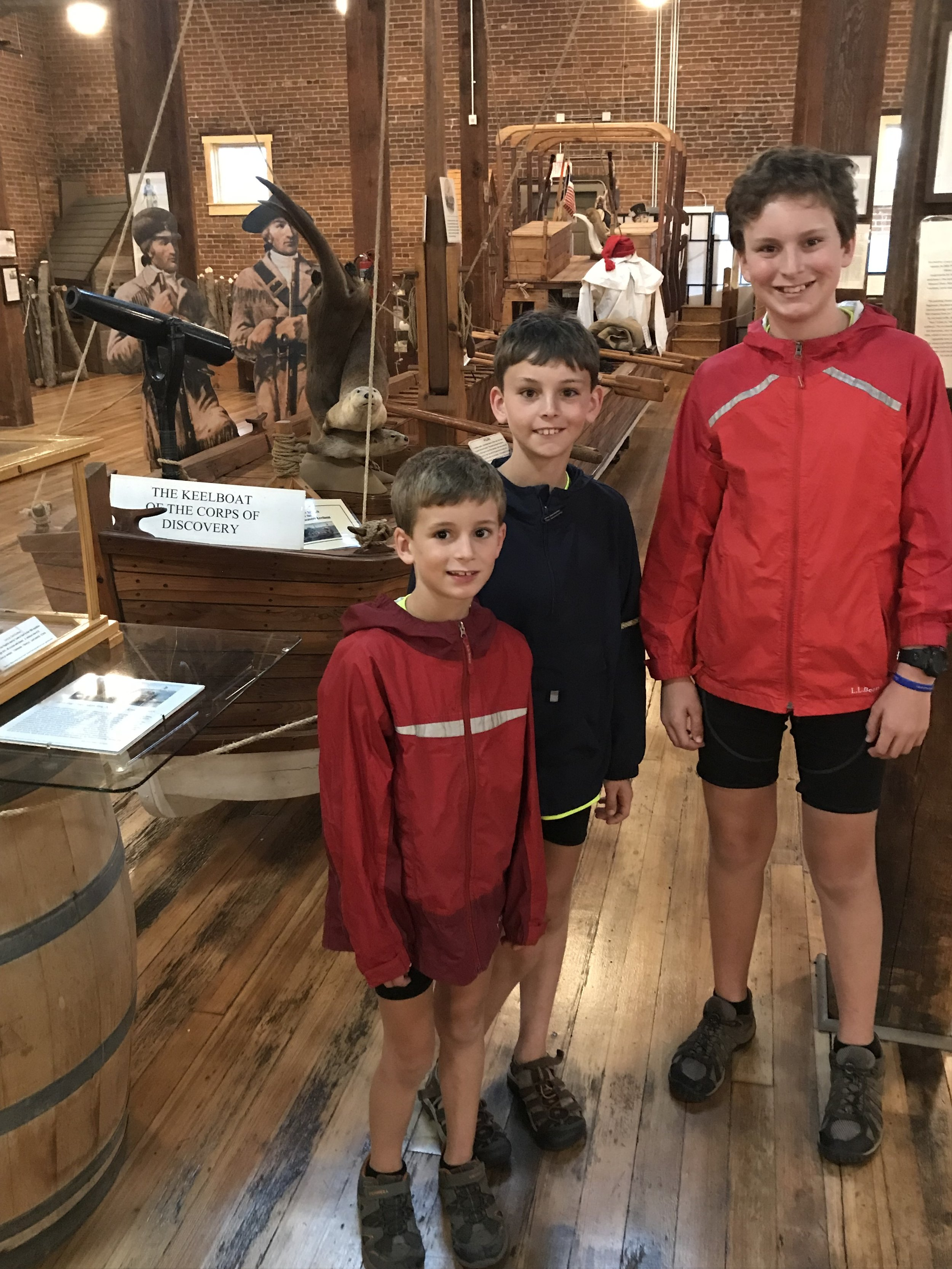 Boonville Museum and Visitors Center. The boys are standing in front of a half-scale replica of Lewis and Clark's keel boat.