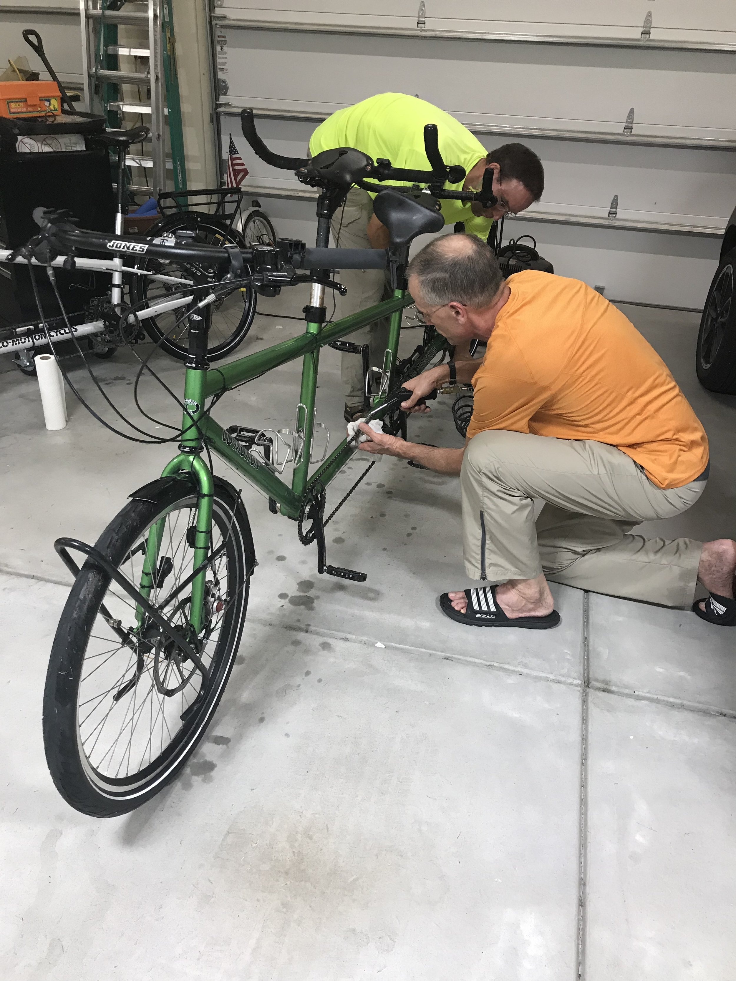 Bill helping Jerry to clean the grime and debris from our bikes after the miles on trails and roads.