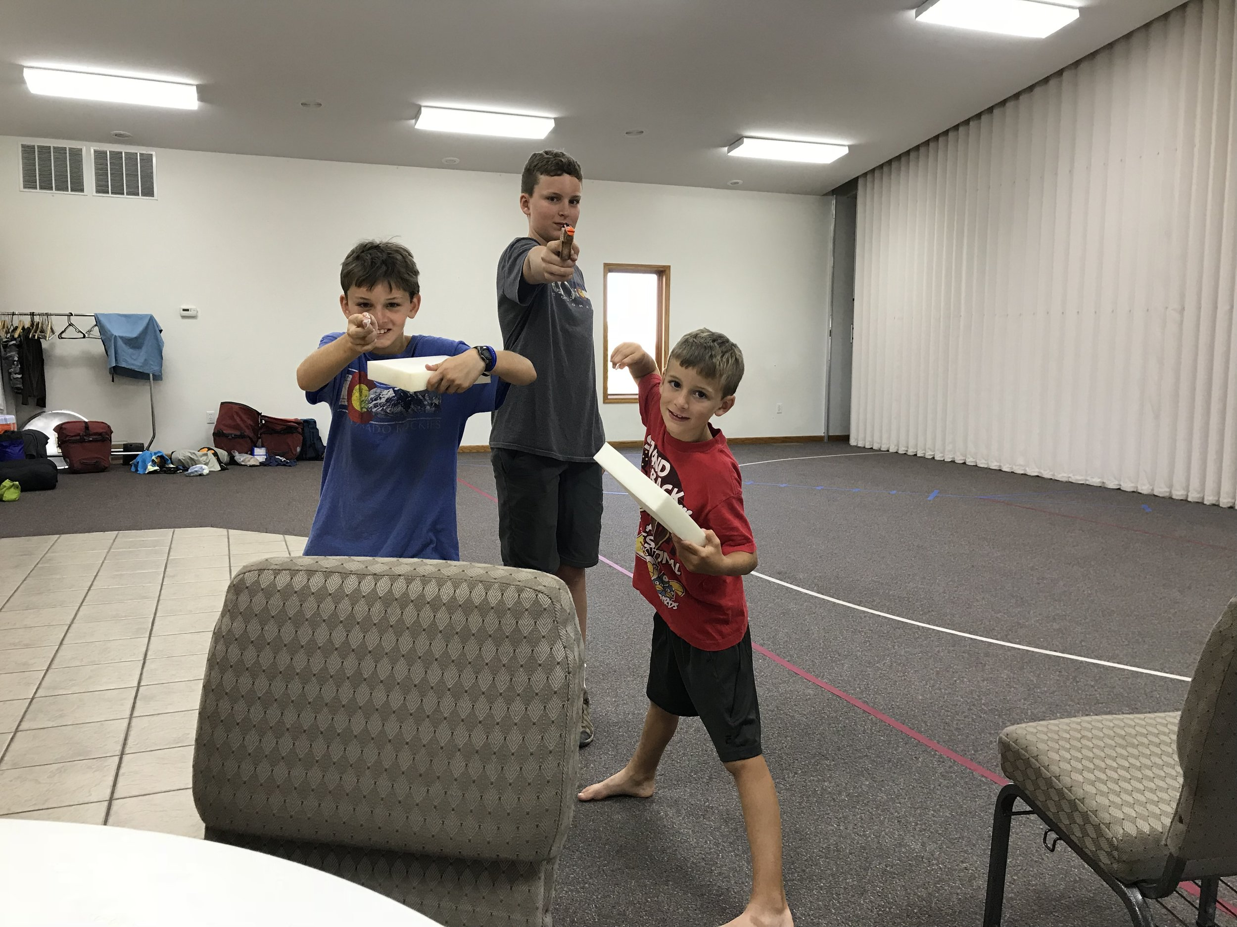 The boys got into a rubber band war in the church's common space (using a rubber band gun Russell had recently bought).