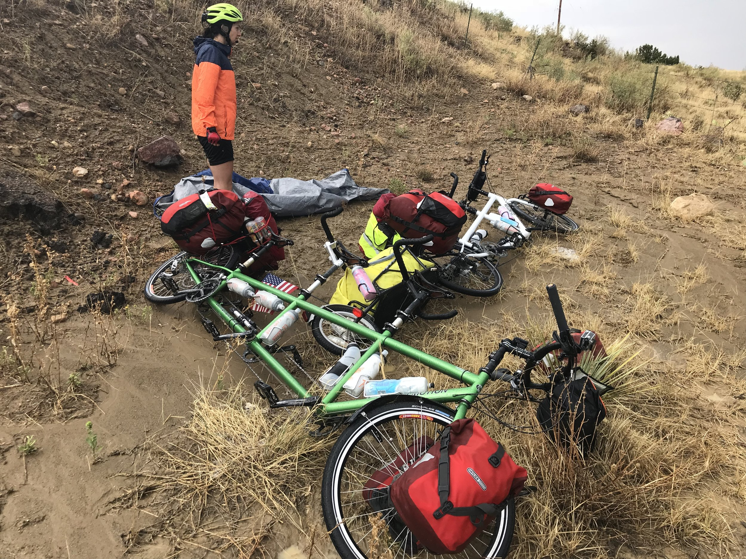 Here are our bikes and tarp in a sloppy, muddy mess after the storm had passed. The bikes were caked in mud even more after we rolled them out of this area back onto the road.