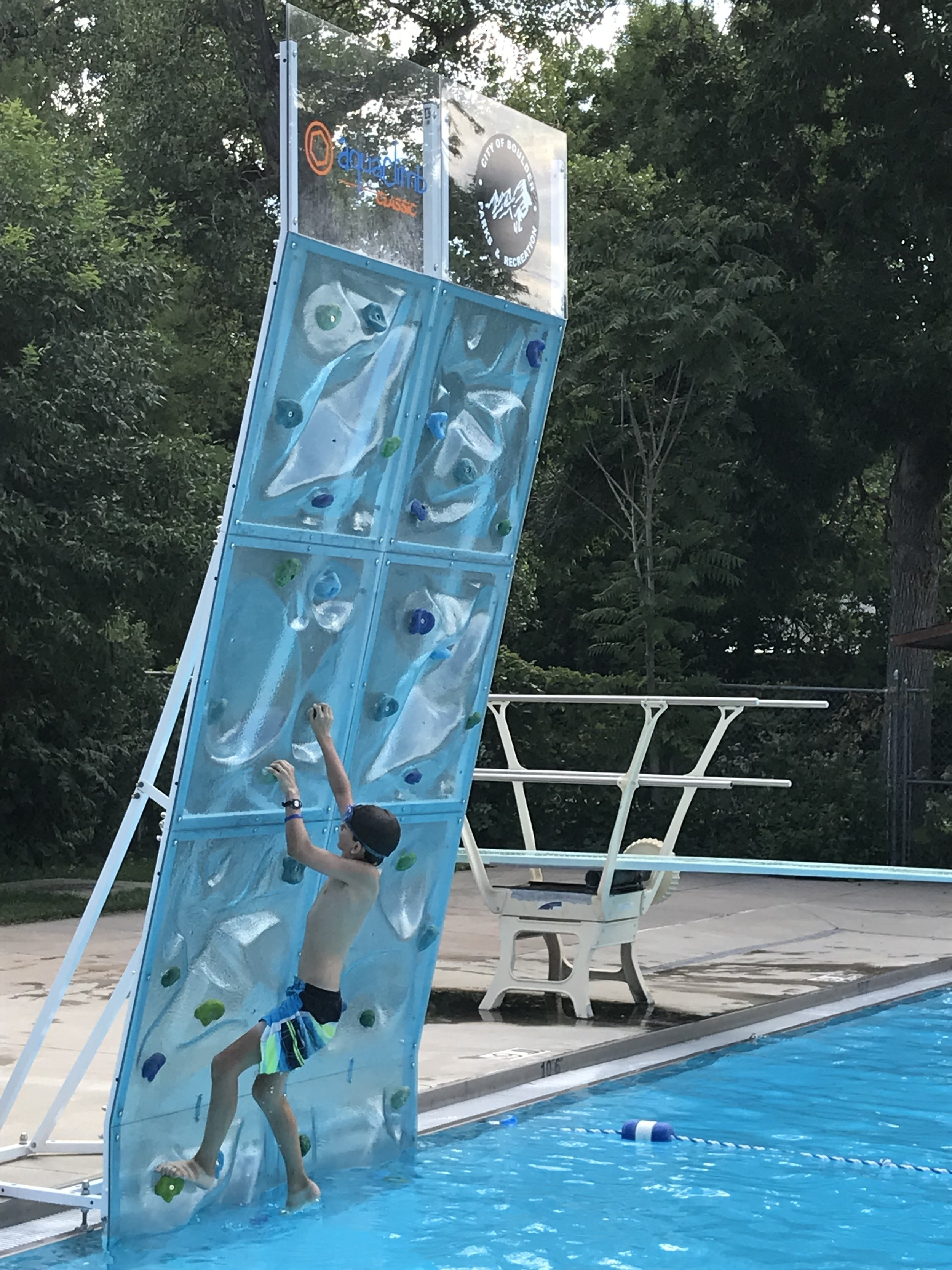 Have you ever seen a climbing wall towering over the deep end of a pool? We hadn't, but boy, was that fun!!