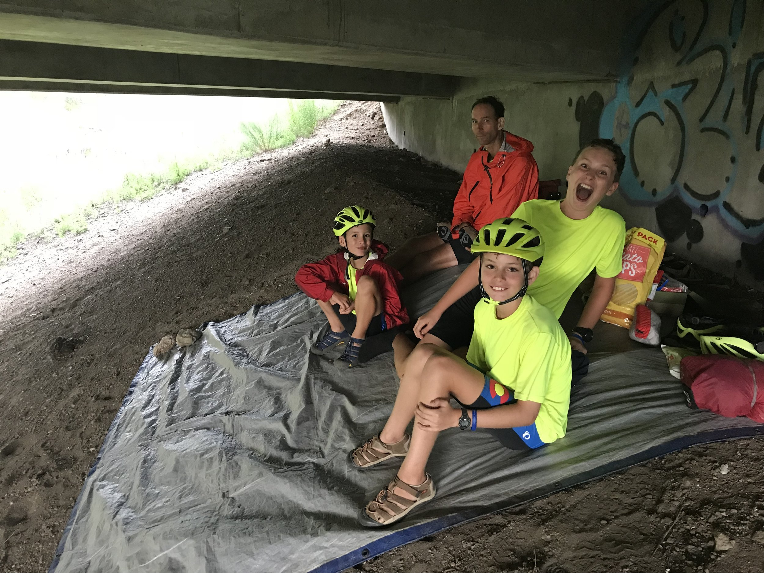 You've heard about several of the storms we have weathered. Here we are under a bridge avoiding another storm that passed after about 30-45 minutes. It was actually a very comfortable place to take shelter. There was even a creek that the boys could play in to let out some creative energy. (See next picture.)