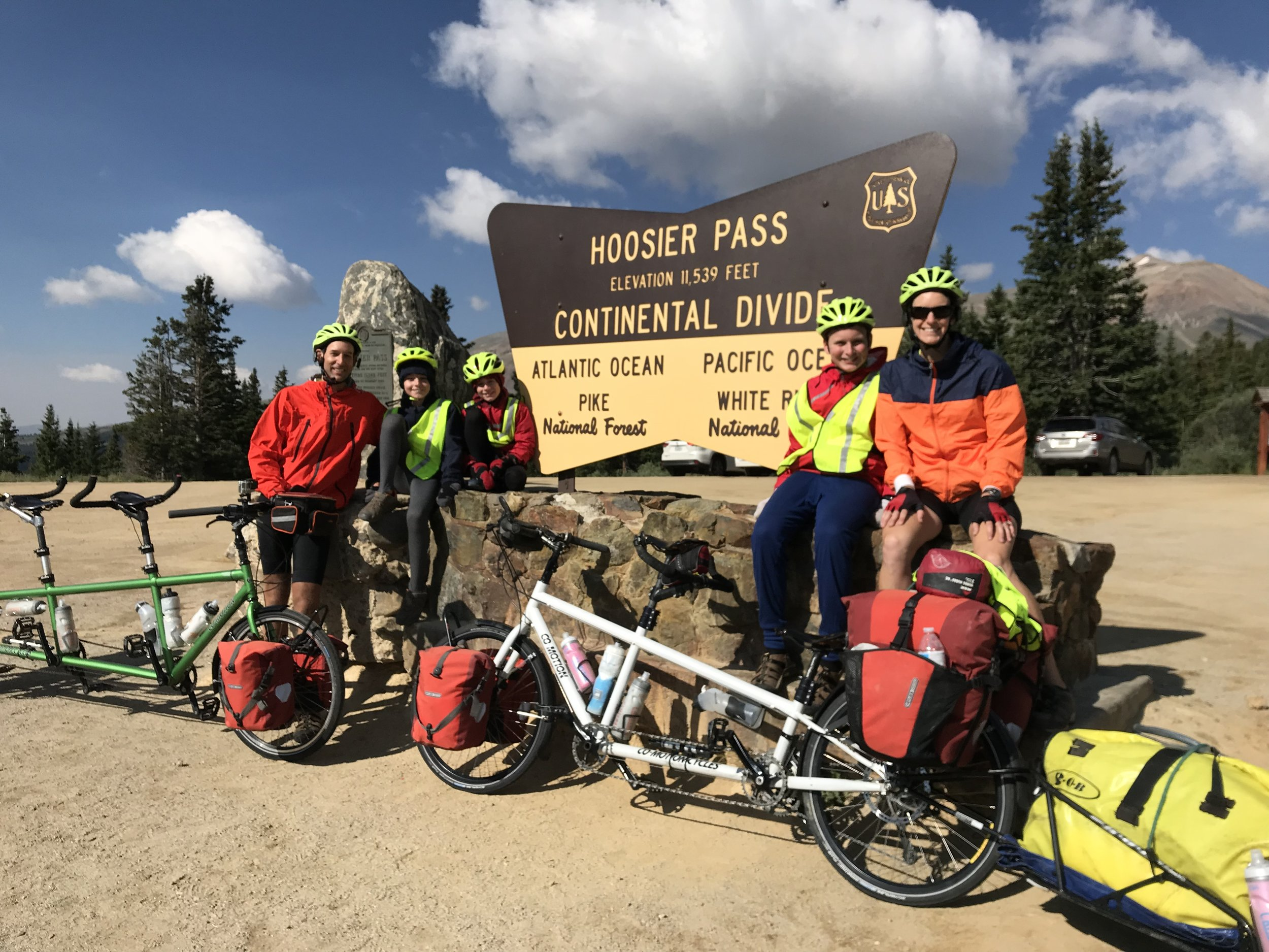 Here is our victory picture after making it up to Hoosier Pass Summit. Notice the socks on the boys' hands and leggings on their legs. It was quite cold and windy!