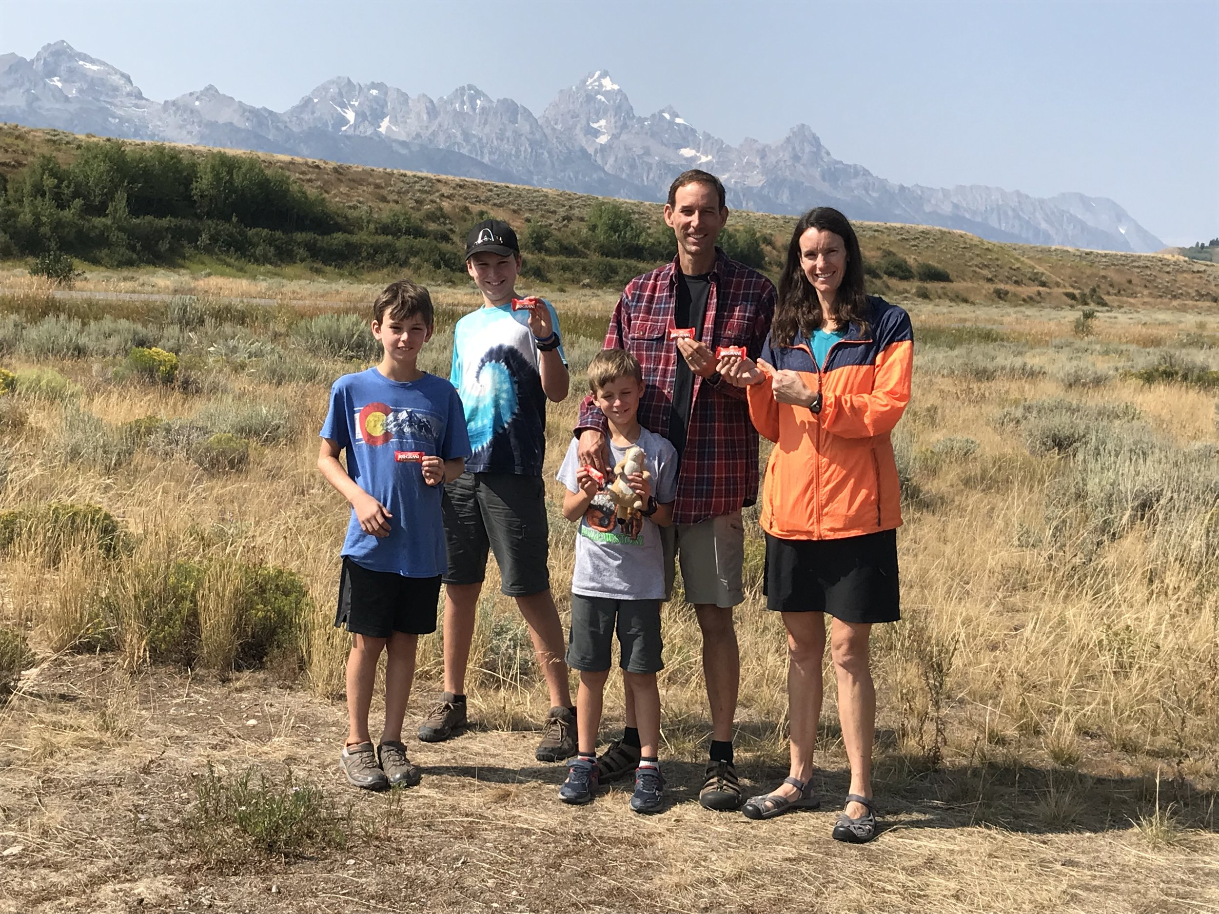 Here we are finally getting ready to eat 100 Grand candy bars in front of the  Grand  Tetons to celebrate our  100 th honk of the Honk-O-Meter.