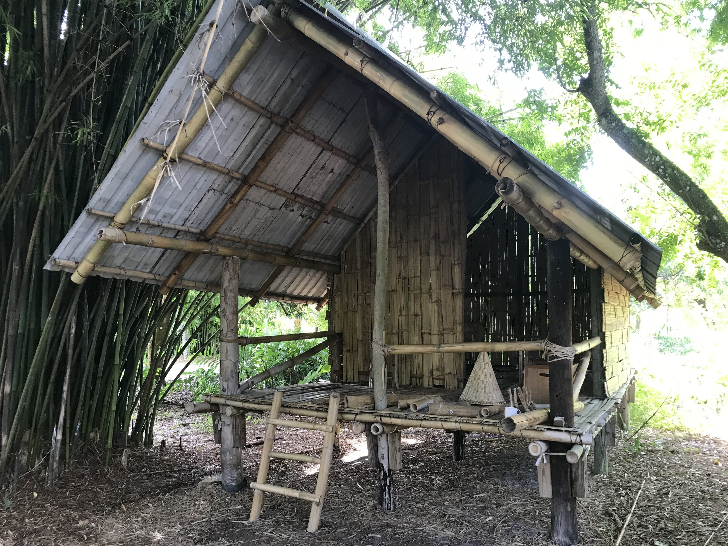 """This is a bamboo house built by interns and staff on the ECHO farm, using bamboo grown on the farm. Training on the farm focuses not only on plants but """"appropriate technology""""—region appropriate food prossessing, cooking, building, and other physical aspects that support families. The ever-present focus is to use materials easily available to locals."""