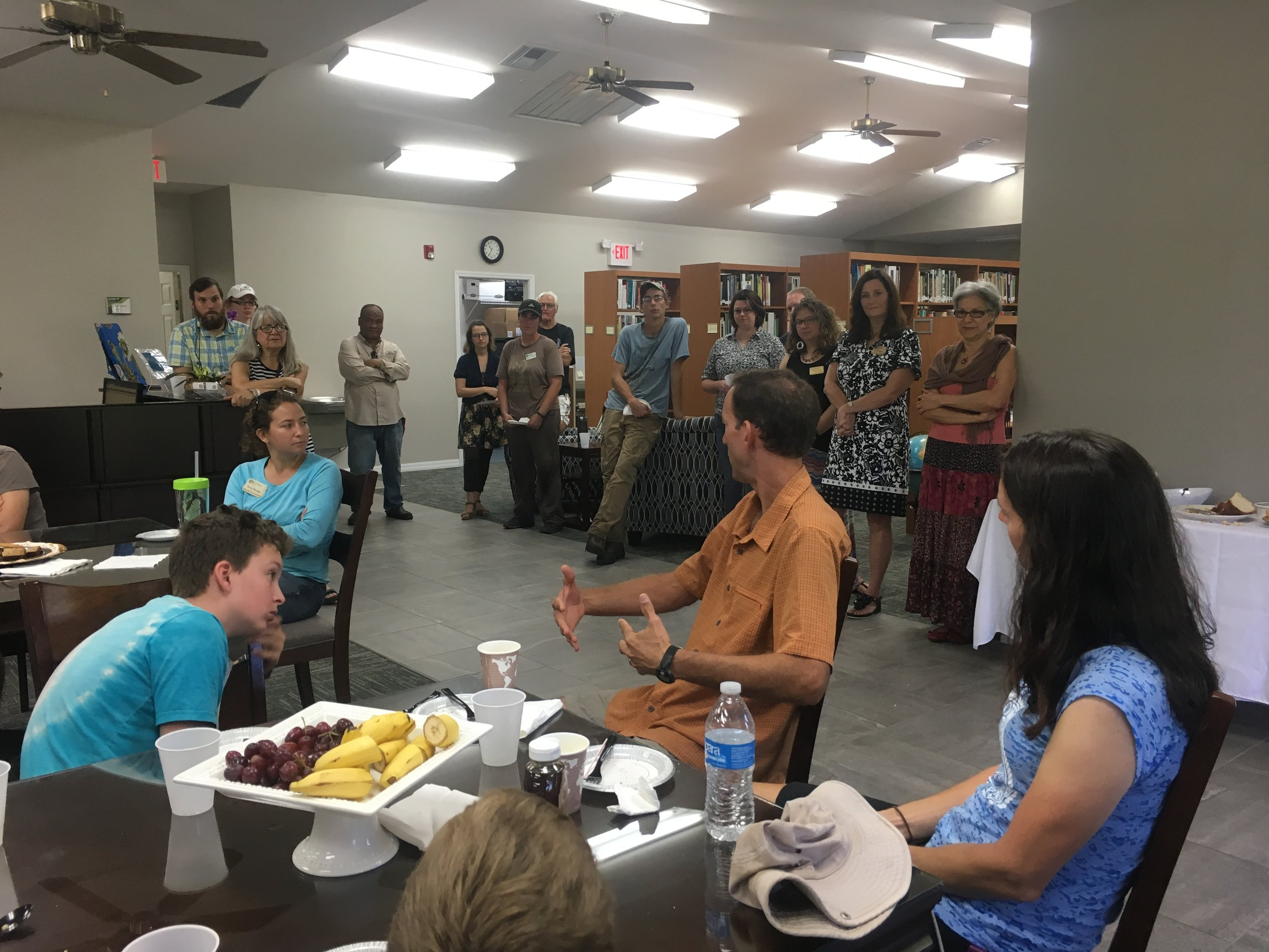 This is a picture of Jerry explaining some aspect of our bike trip with the ECHO staff and interns at the reception that they had for us. From this perspective, you can only see about a third of the folks that had attended.
