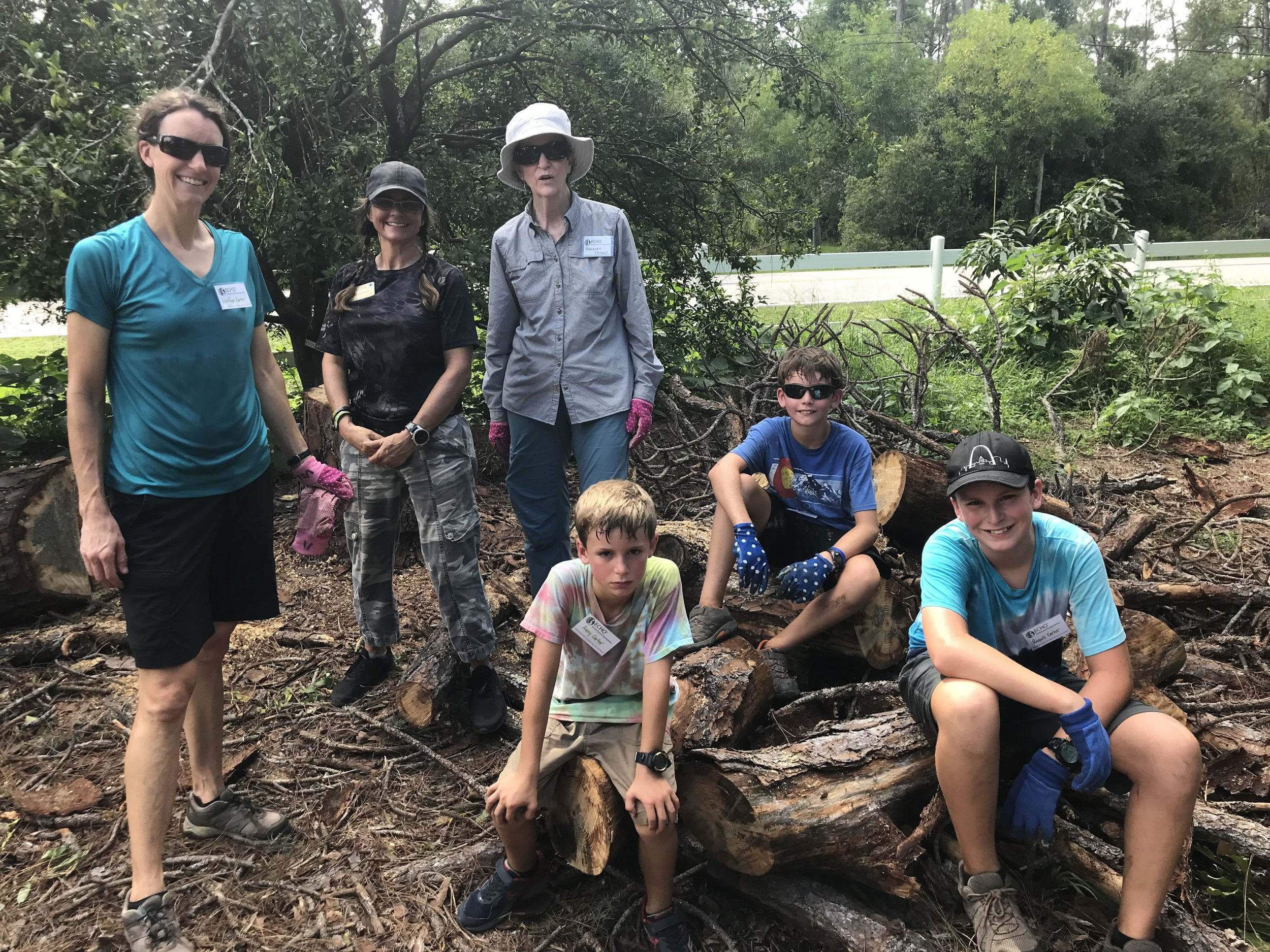 This is our sweaty bunch during a fulfilling time of volunteering on the farm. ECHO staff member, Heidi, whom we worked with (Jerry taking the picture).