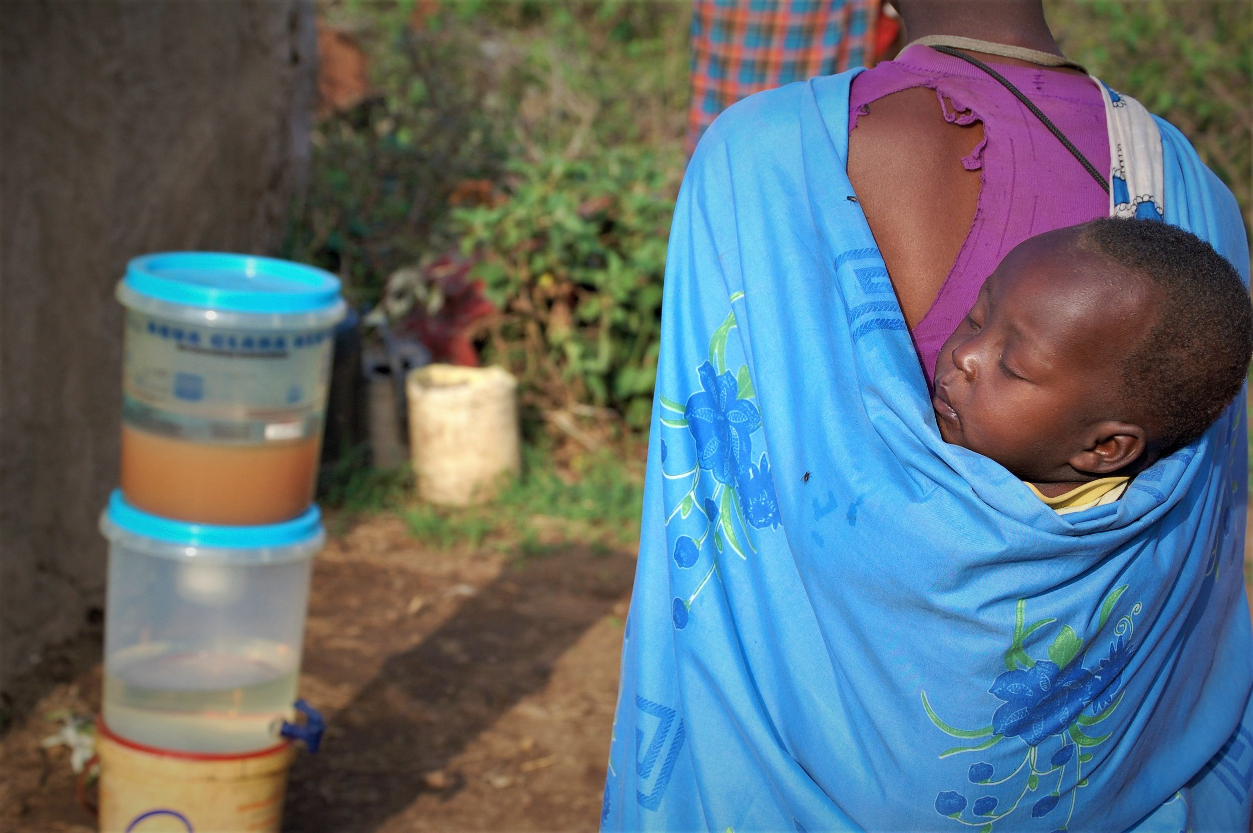 You can't talk about clean water without talking about motherhood, and I feel like this picture captures that perfectly.