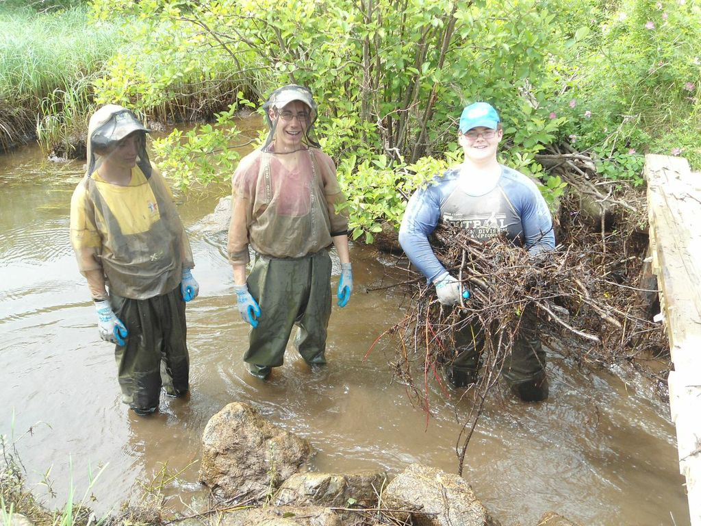 Members of the Cheticamp River Salmon Association restoration team:Antoine Aucoin (left), Kyle Lefort (centre), and Jeremy Camus (right), while removing a beaver dam on Aucoin's brook.