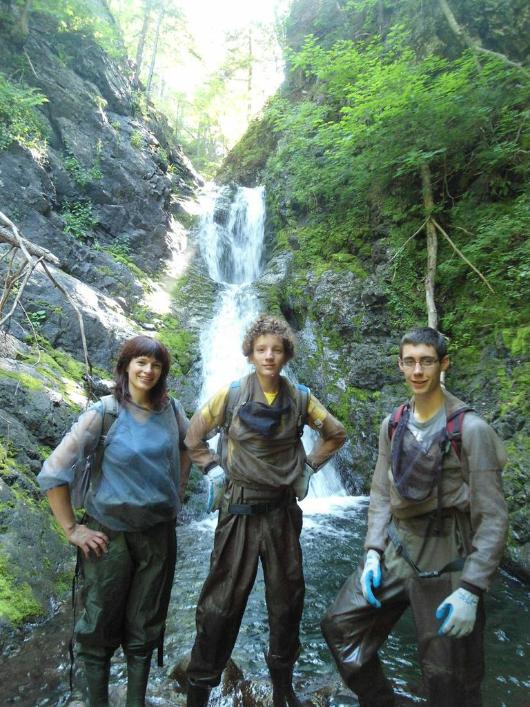 Members of the Cheticamp River Salmon Association restoration team: Jillian Baker (left), biologist, Antoine Aucoin (centre), and Kyle Lefort (right) stop for a picture while doing monitoring/surveying work on Aucoin's Brook.