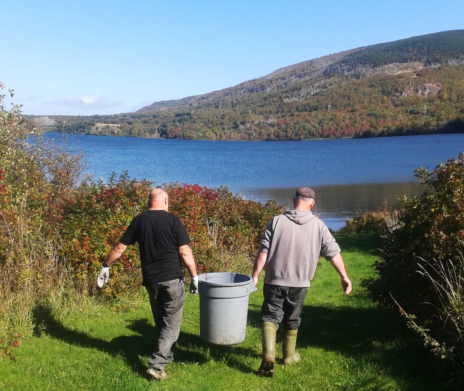 Lenny and Joel taking a load of trout down to Grand Lac.