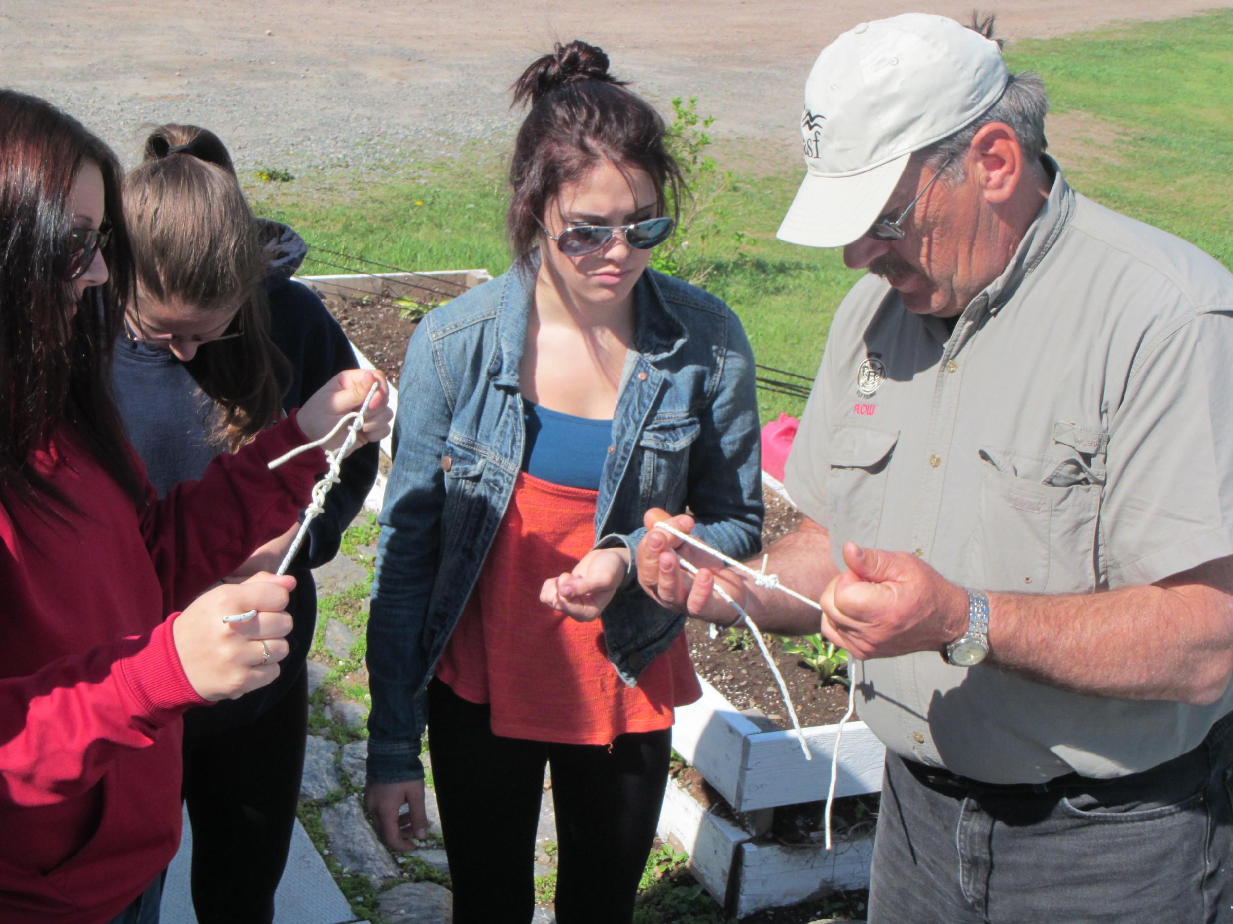 John Hart demonstrates how to tie basic knots.