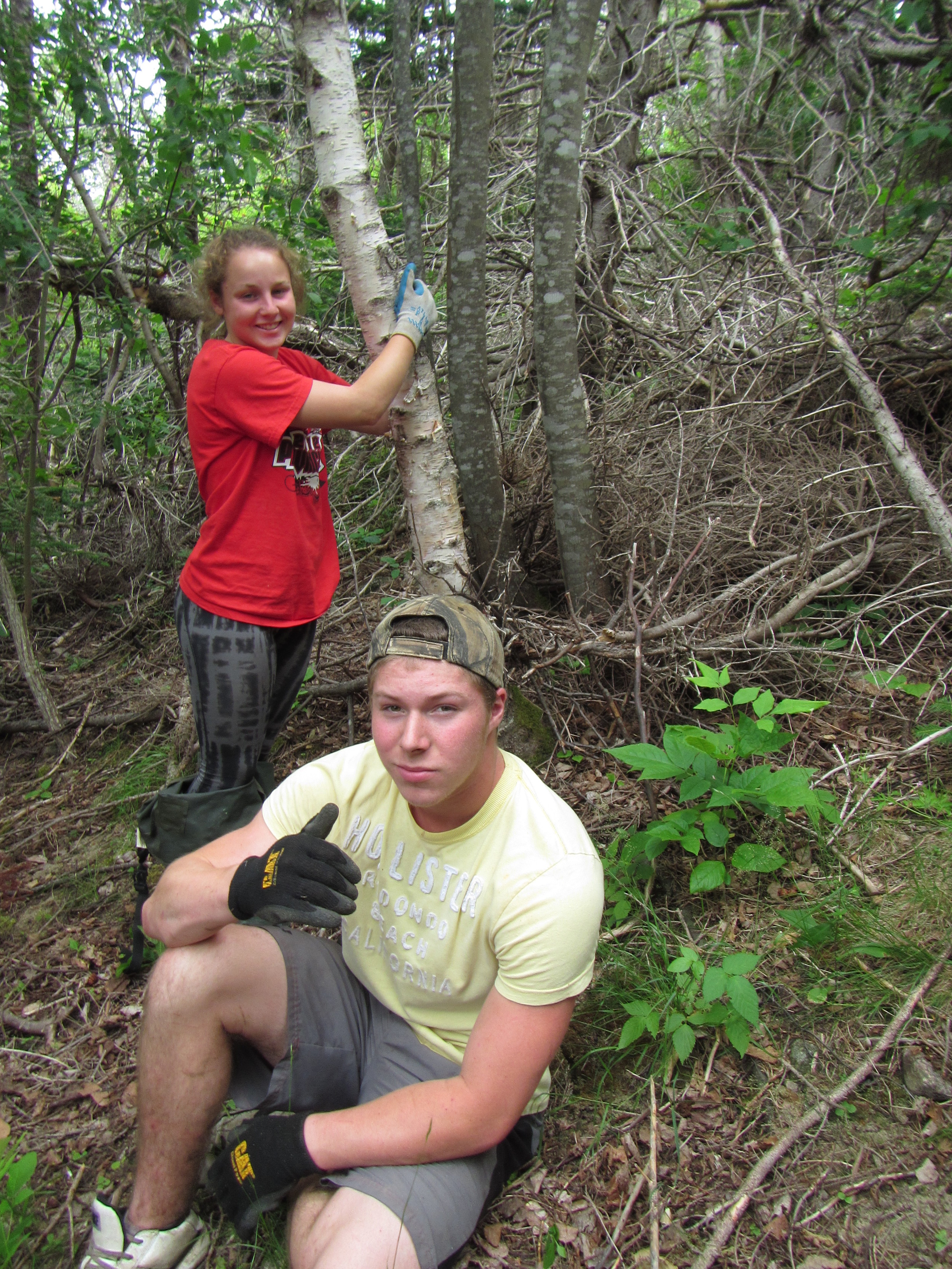 Rachelle Aucoin and Logan Lapierre taking a break after completing the walking trail!
