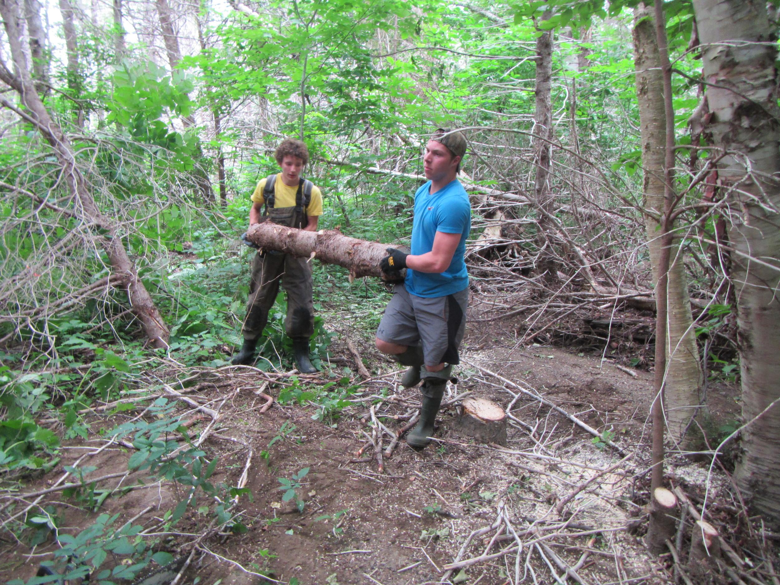 Antoine Aucoin and Logan Lapierre removing debris.