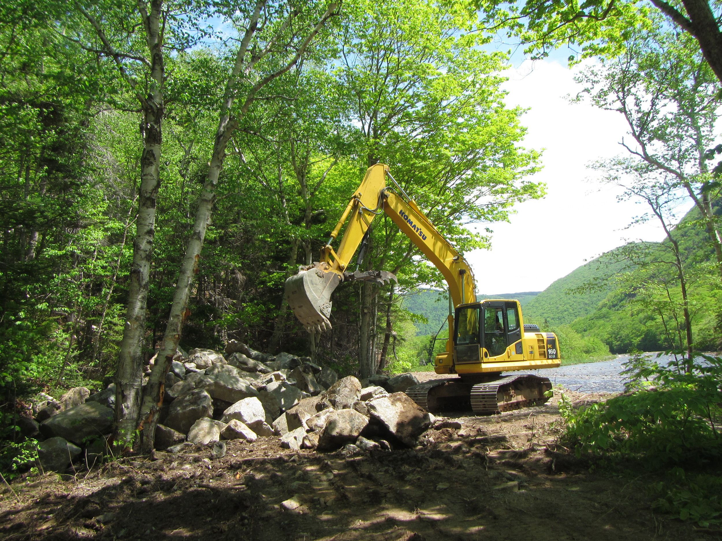 Moving boulders into the pile.