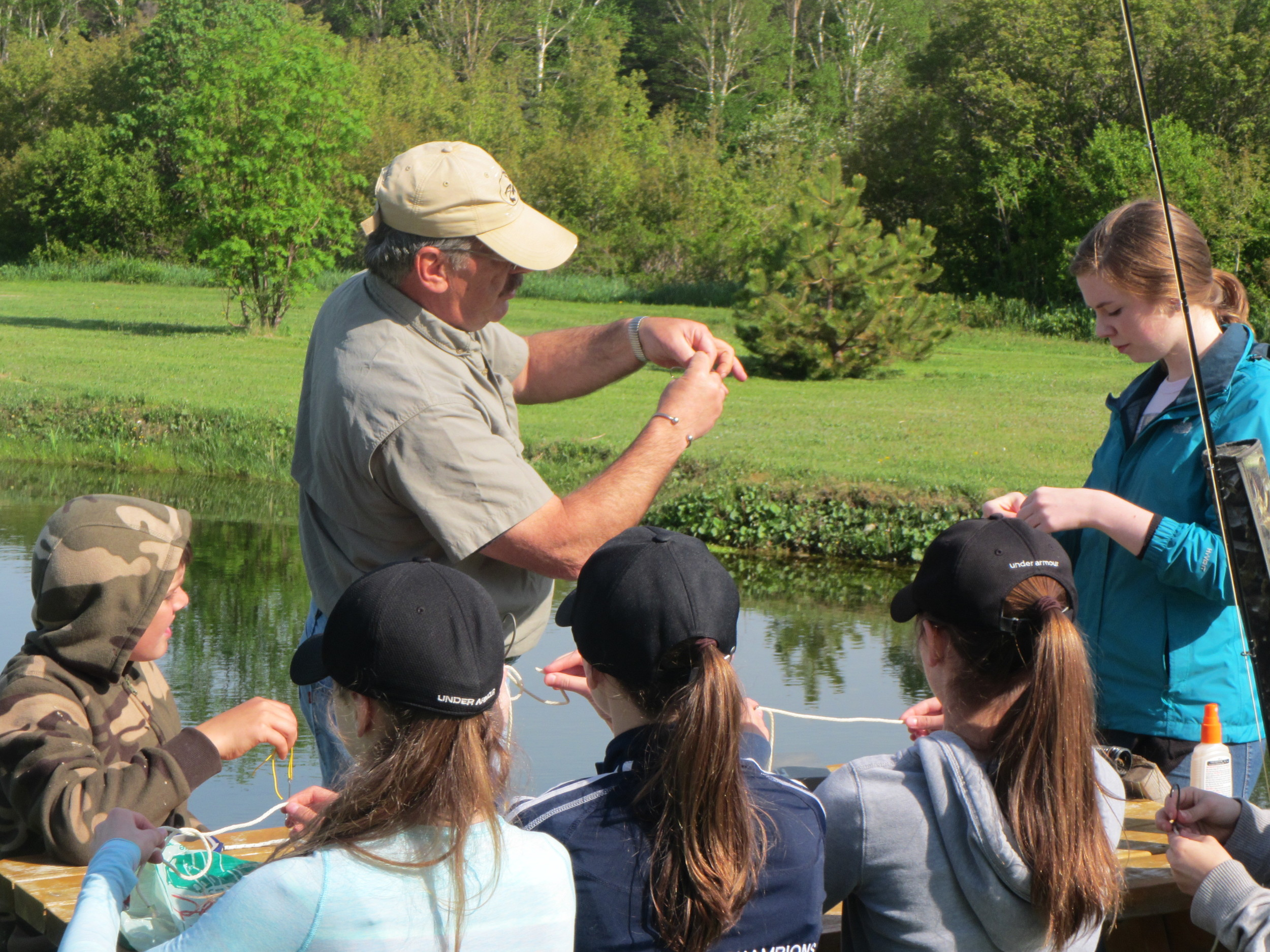 John shows the grade 7 class how to tie some simple fly knots.