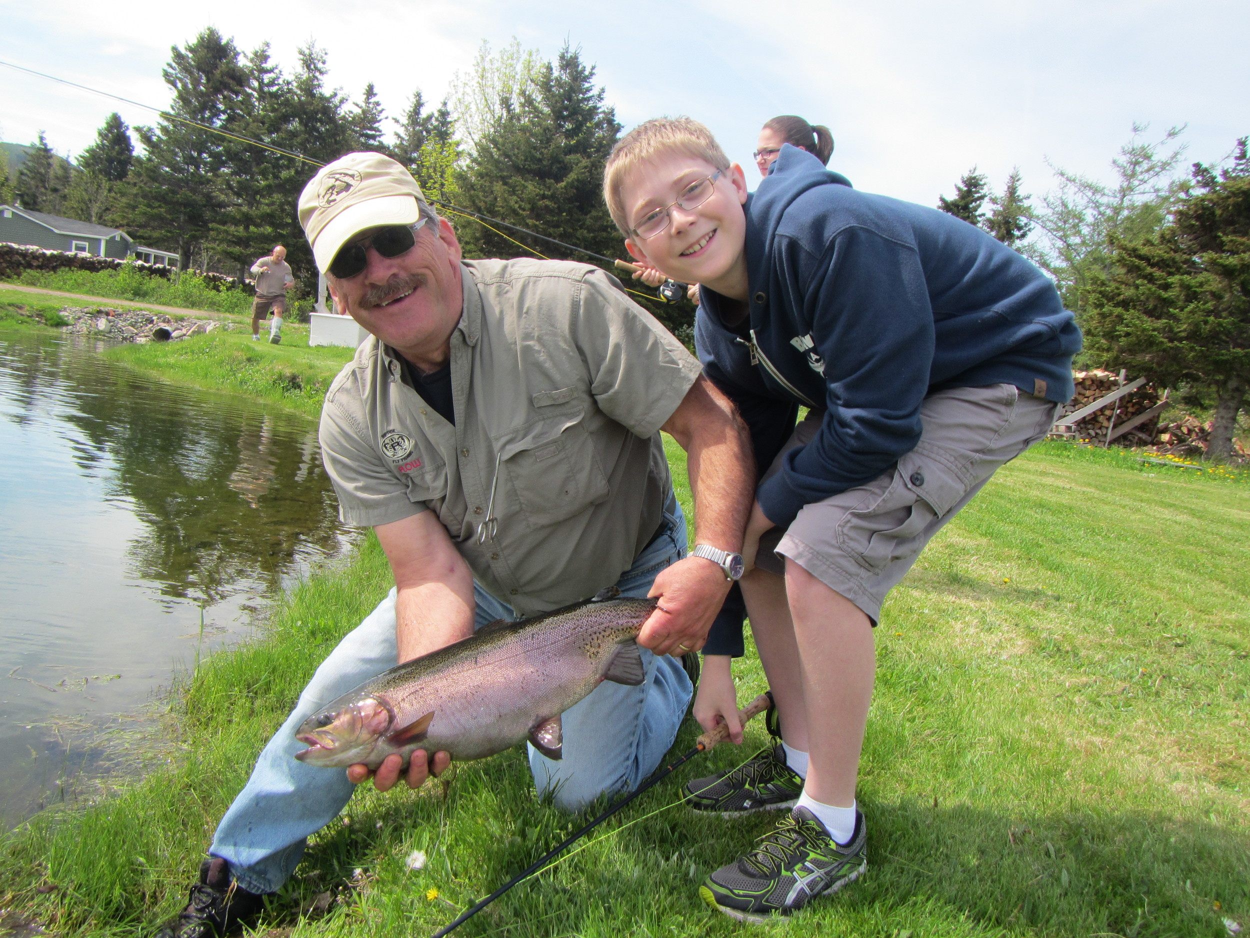 John poses with one of the grade 7's with his big catch!
