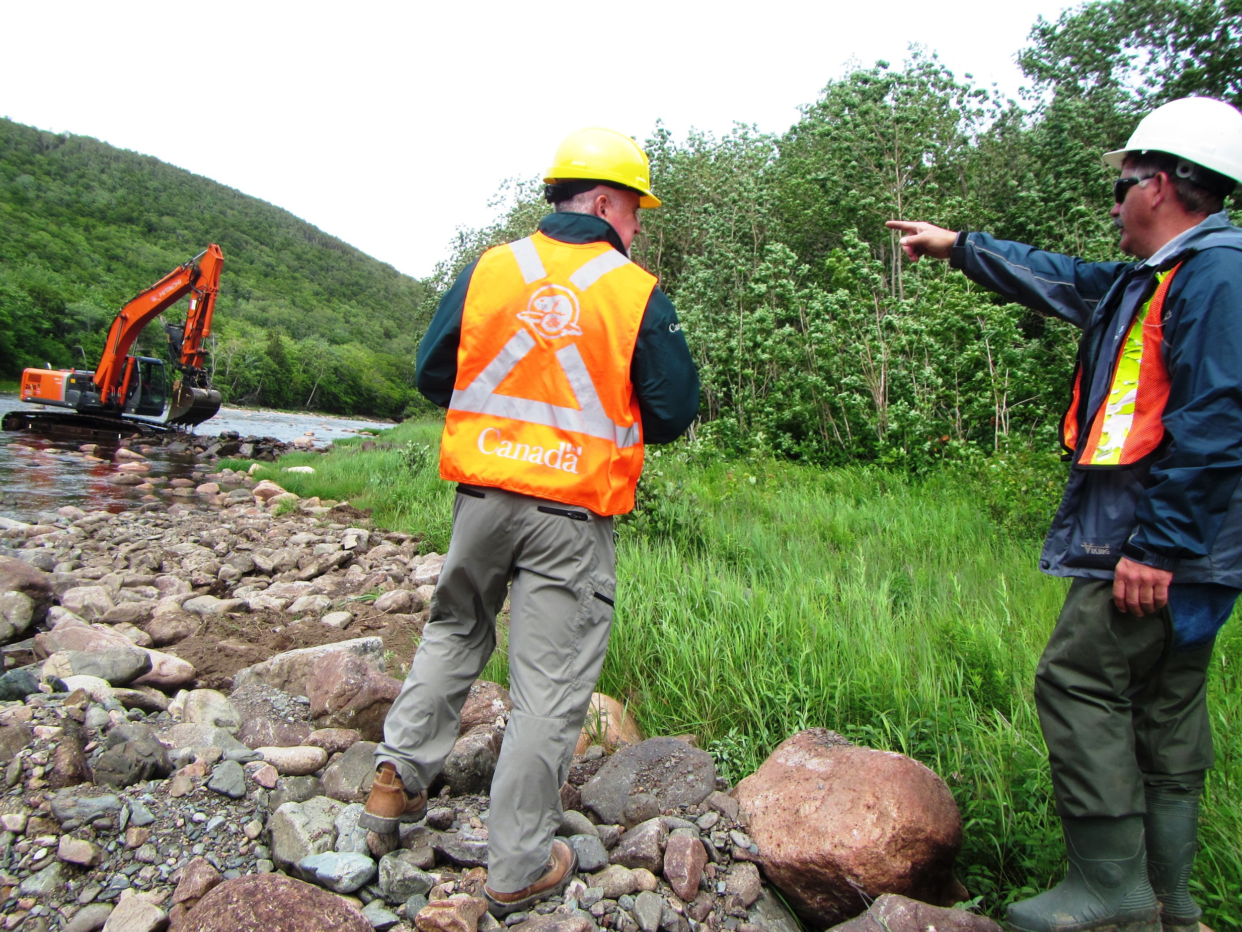 Project consultant points out locations for further instream structures