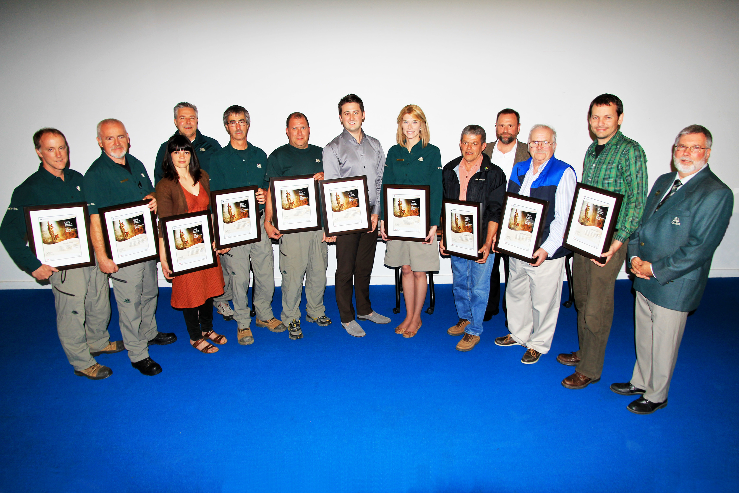 Parks Canada CEO Award recipients and presenters, from left to right: Jerry LeBlanc, Archie Doucette, Jillian Baker, Blair Purdy (Field Unit Superintendent for Cape Breton Field Unit), Willie Deveau, Jacques Chiasson, Coady Slaunwhite, Kelly Deveaux, Claudie Maillet, George Green (Parks Canada's Vice-President of Heritage Conservation and Commemoration), James Bridgland, Chris Bellemore, and Derek Quann (Acting Superintendent for Cape Breton Highlands National Park).