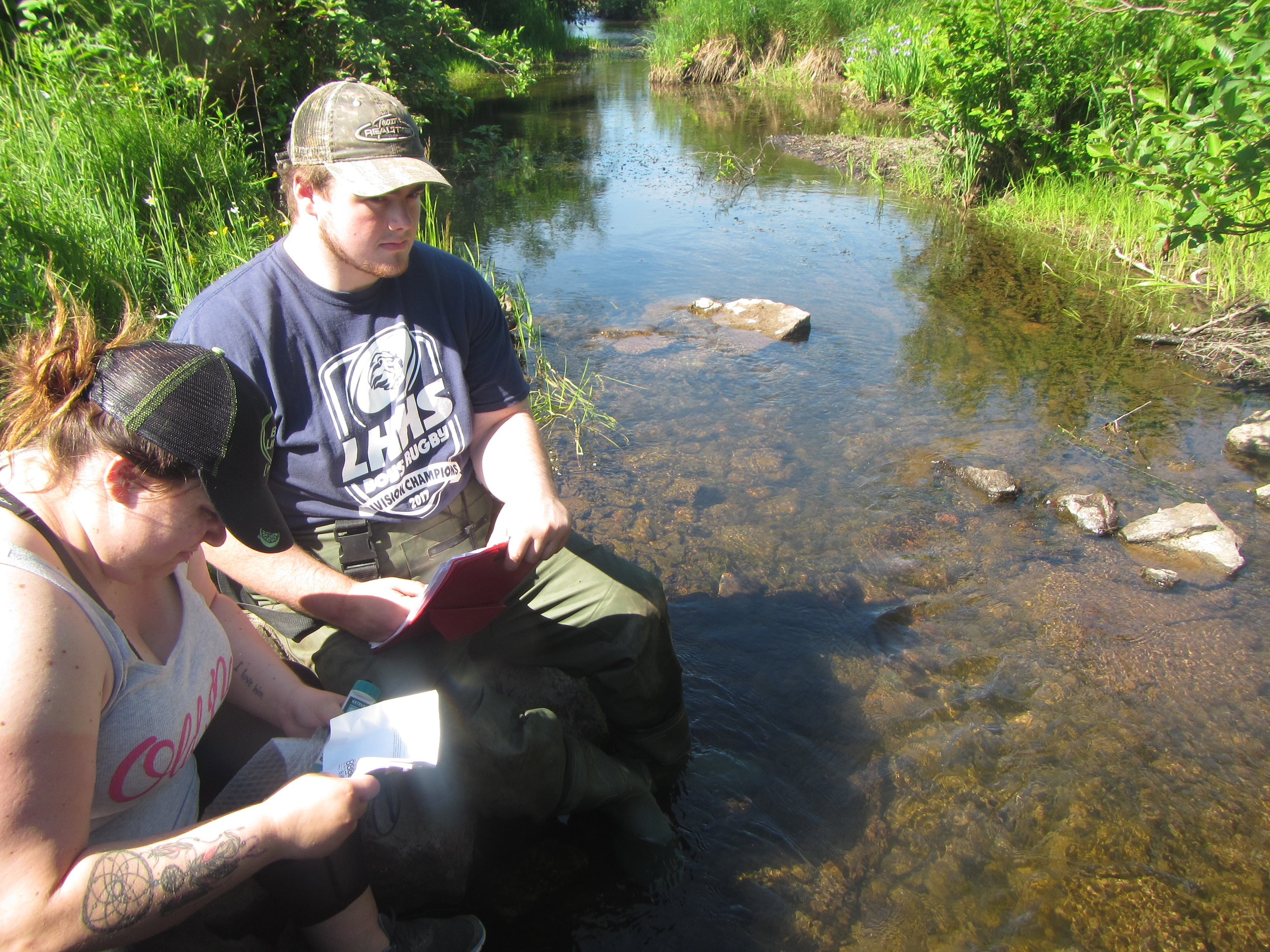 Kayla Blackwood and Jeremy Camus completing a site visit as part of the CRSA's ecological monitoring program