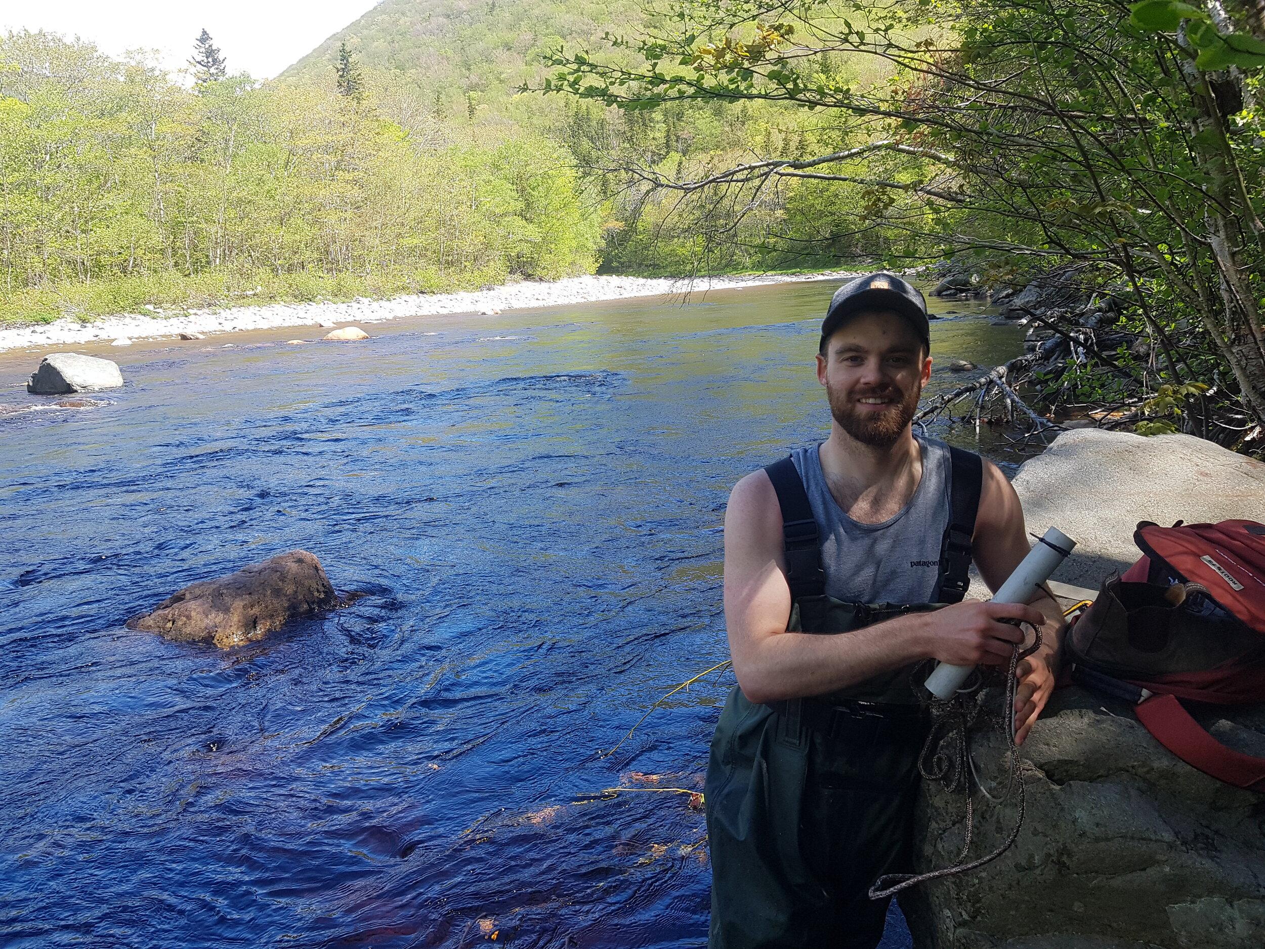 Matt Fraser, CRSA's Habitat Restoration Crew Leader this summer, helped install water temperature loggers on the Cheticamp River