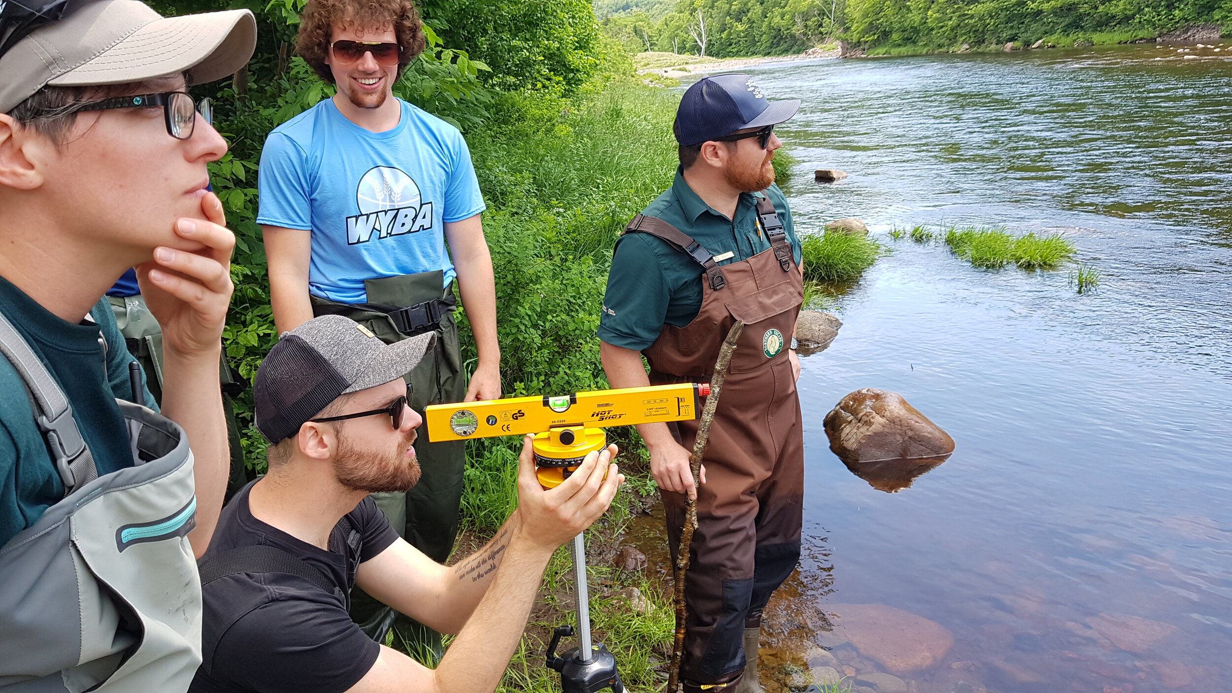 CRSA and Parks Canada staff working together to collect elevation data as part of habitat assessments on Cheticamp River