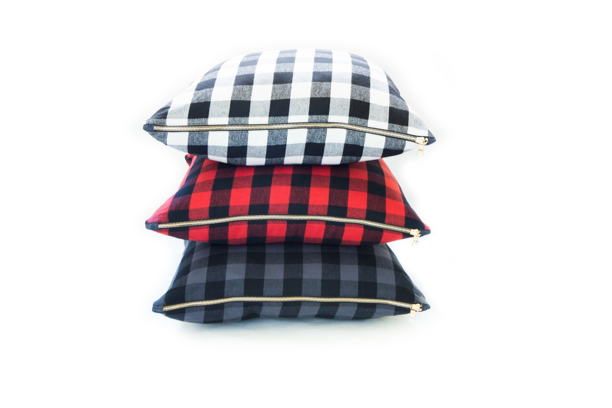 New collection of Buffalo Check Pillows with exposed gold zipper detail.
