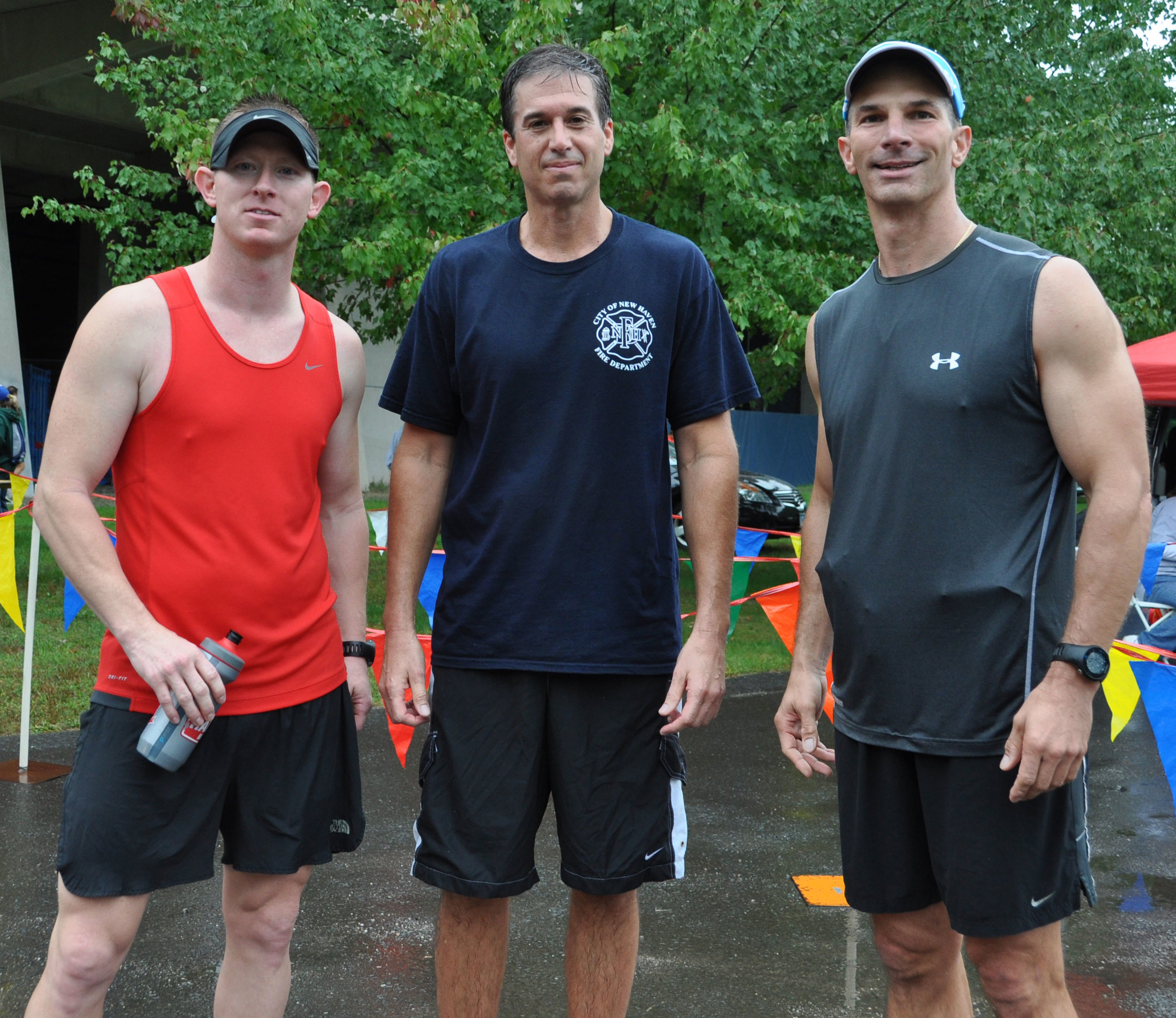 Firefighters KC Klett, Mike Pozika and John Sheppa ran a relay from New Britain to New Haven to raise money for the Tommy Fund